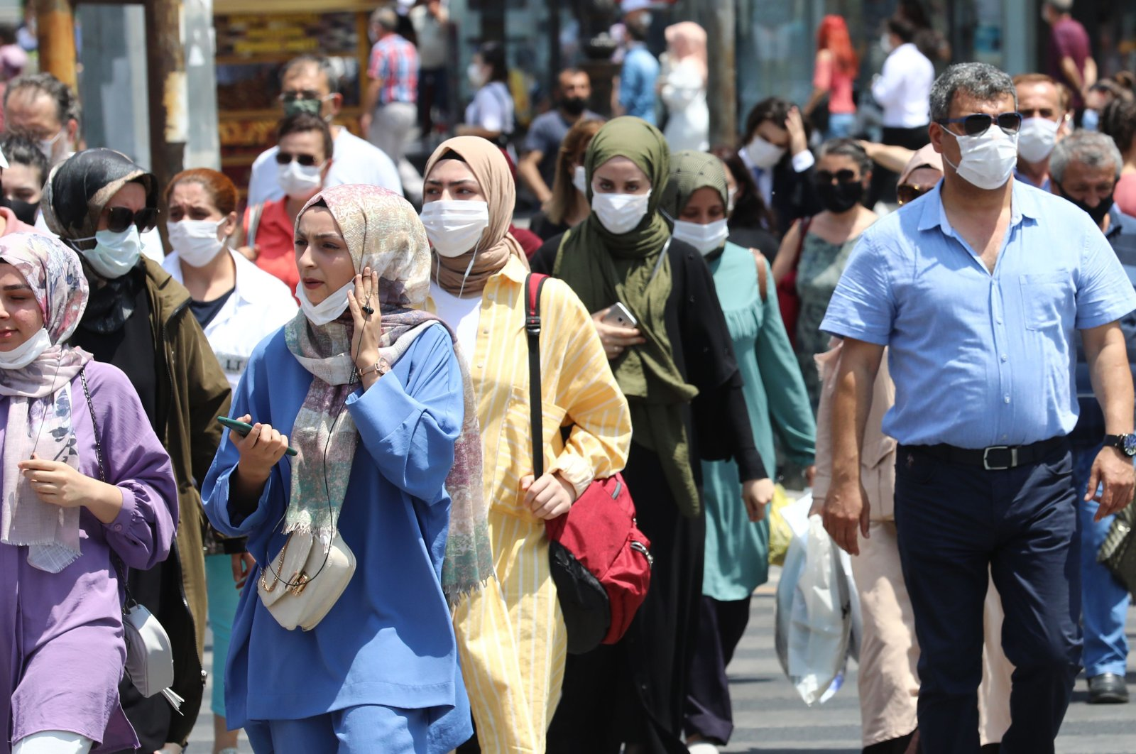 People wearing face masks walk downtown in Ankara, July 7, 2020. (AFP Photo)