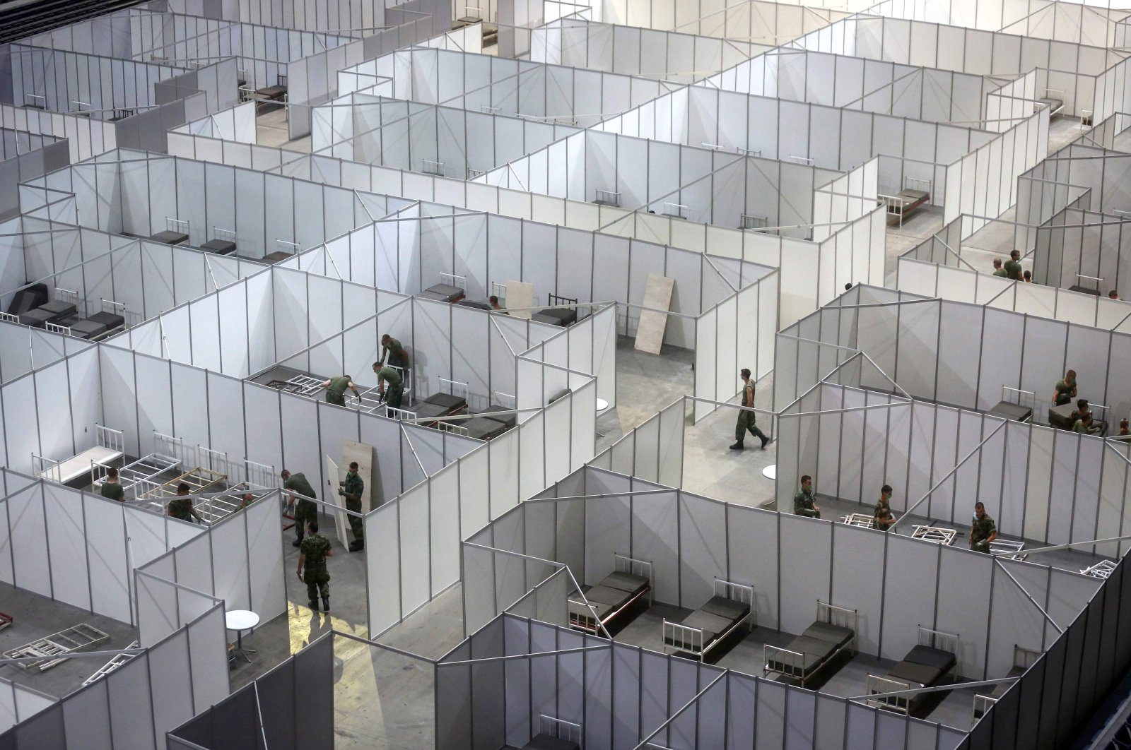 Serbian army soldiers prepare a makeshift field hospital to accommodate patients infected by COVID-19 inside the Belgrade Arena, on July 6, 2020. (AFP Photo)