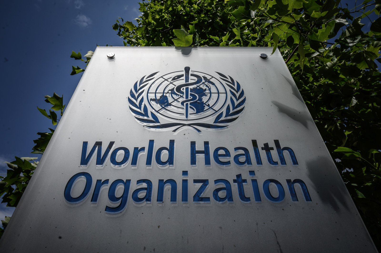 A sign of the World Health Organization (WHO) at their headquarters in Geneva, amidst the COVID-19 outbreak, caused by the novel coronavirus, July 3, 2020. (Photo by Fabrice COFFRINI / AFP)