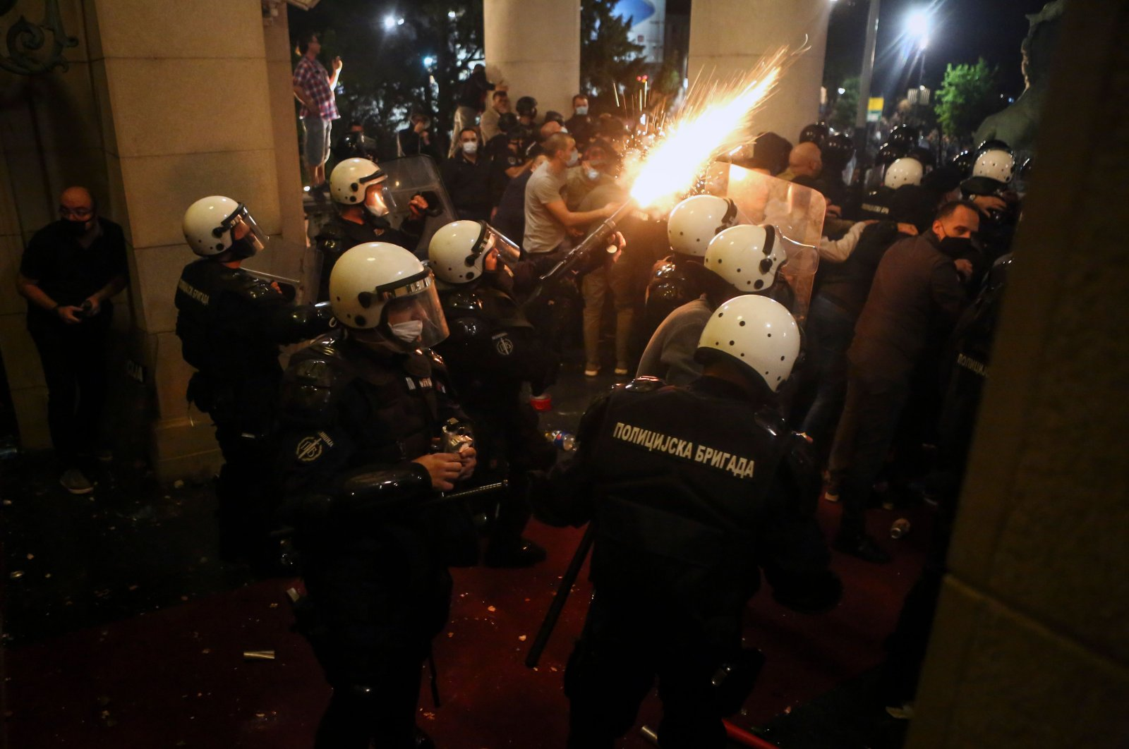 Protesters scuffle with police in front of the National Assembly building in Belgrade, Serbia, July 7, 2020. (AFP Photo)