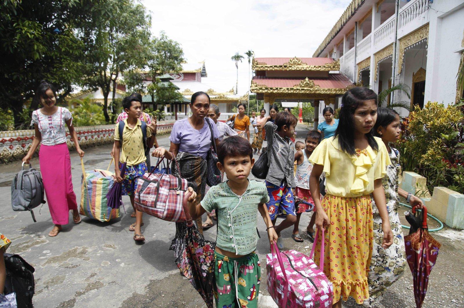 Ethnic Rakhine villagers arrive at a temporary monastery camp with their belongings, in Sittwe, Rakhine State, Myanmar, June 29, 2020. (AP Photo)