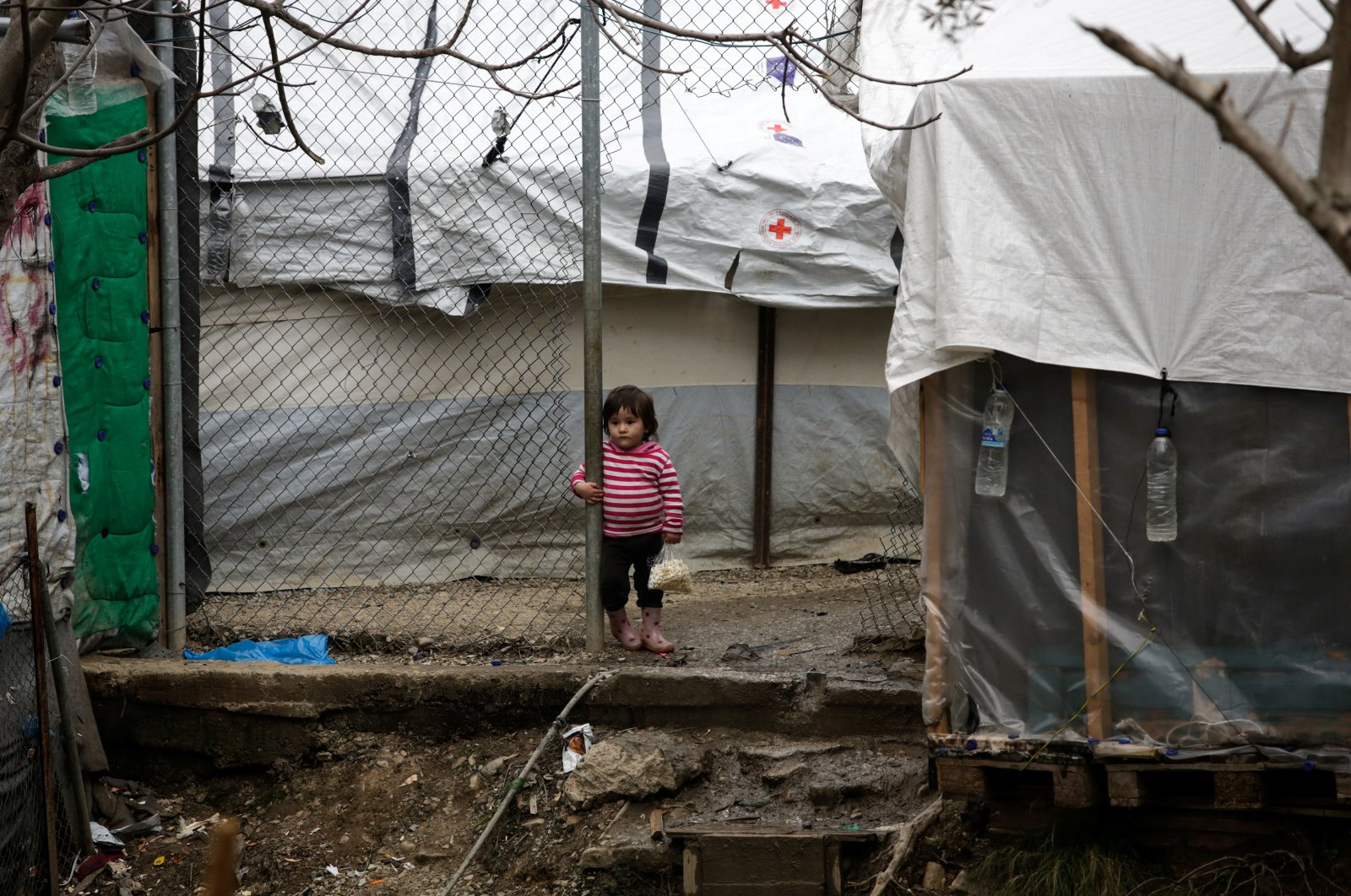 A girl stands among makeshift shelters at a camp for refugees and migrants next to the Moria camp, on the island of Lesbos, Greece, March 9, 2020. (Reuters Photo)
