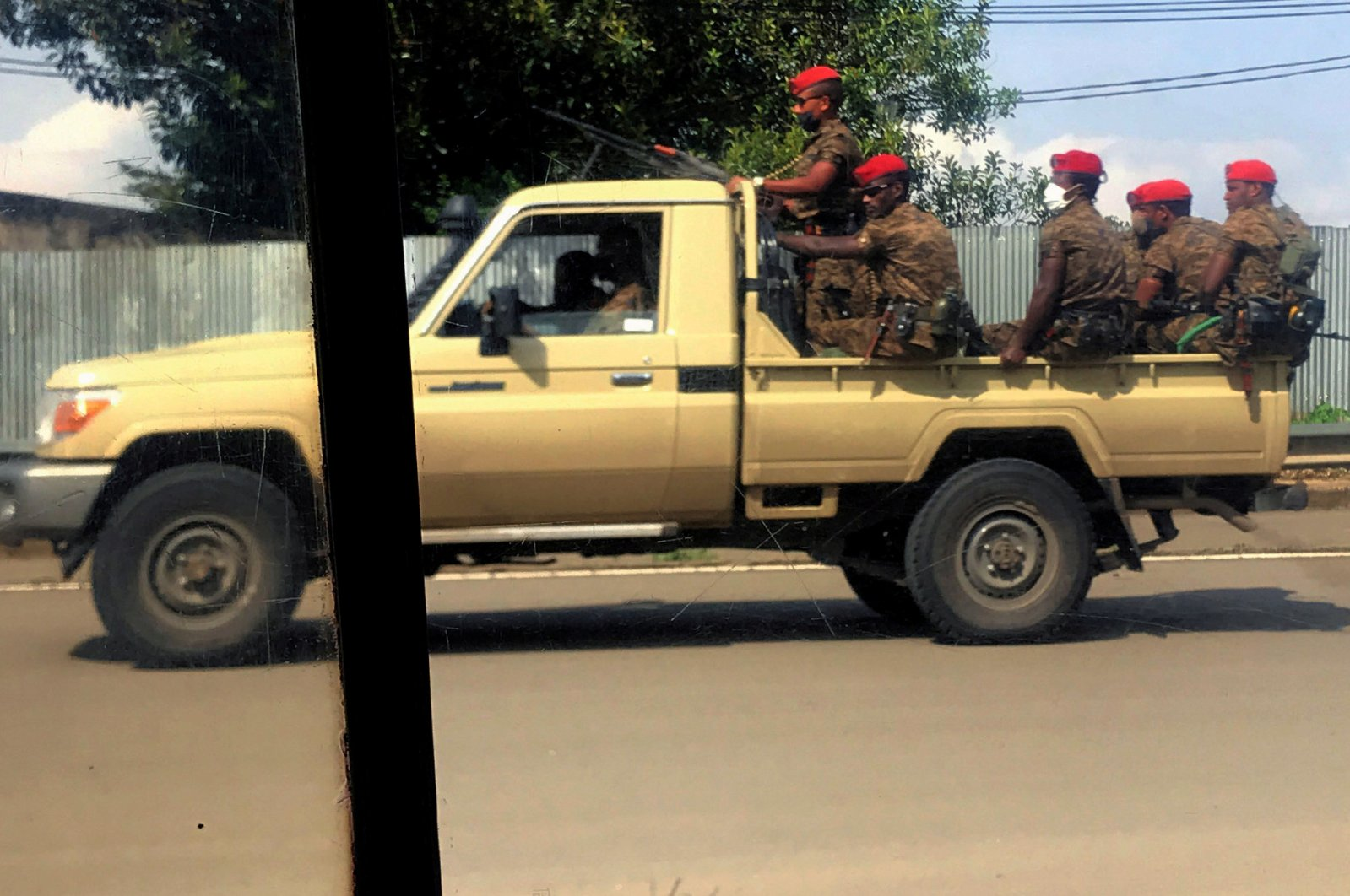 Ethiopian military ride on their pick-up truck as they patrol the streets following protests in Addis Ababa, Ethiopia on July 2, 2020. (Reuters Photo)