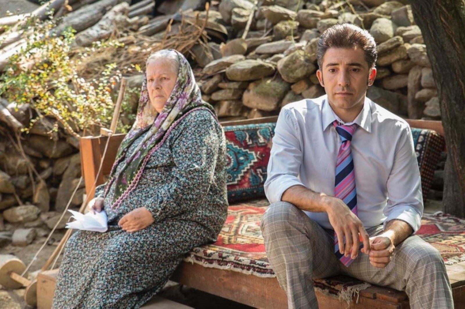"Still shot showing Jale Aylanç (R) with Mert Turak in a scene of TV series titled ""Yeşil Deniz""."