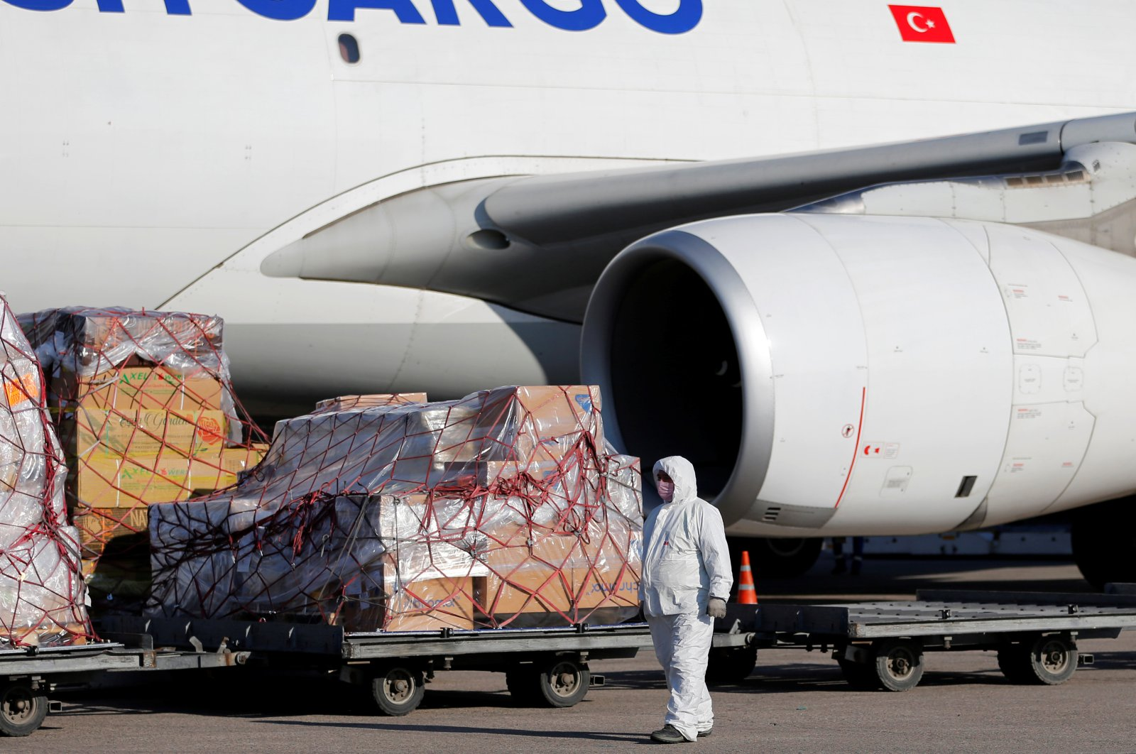 A worker in protective gear unloads a shipment of medical supplies from Turkey, Almaty International Airport, Kazakhstan, April 18, 2020. (Reuters Photo)