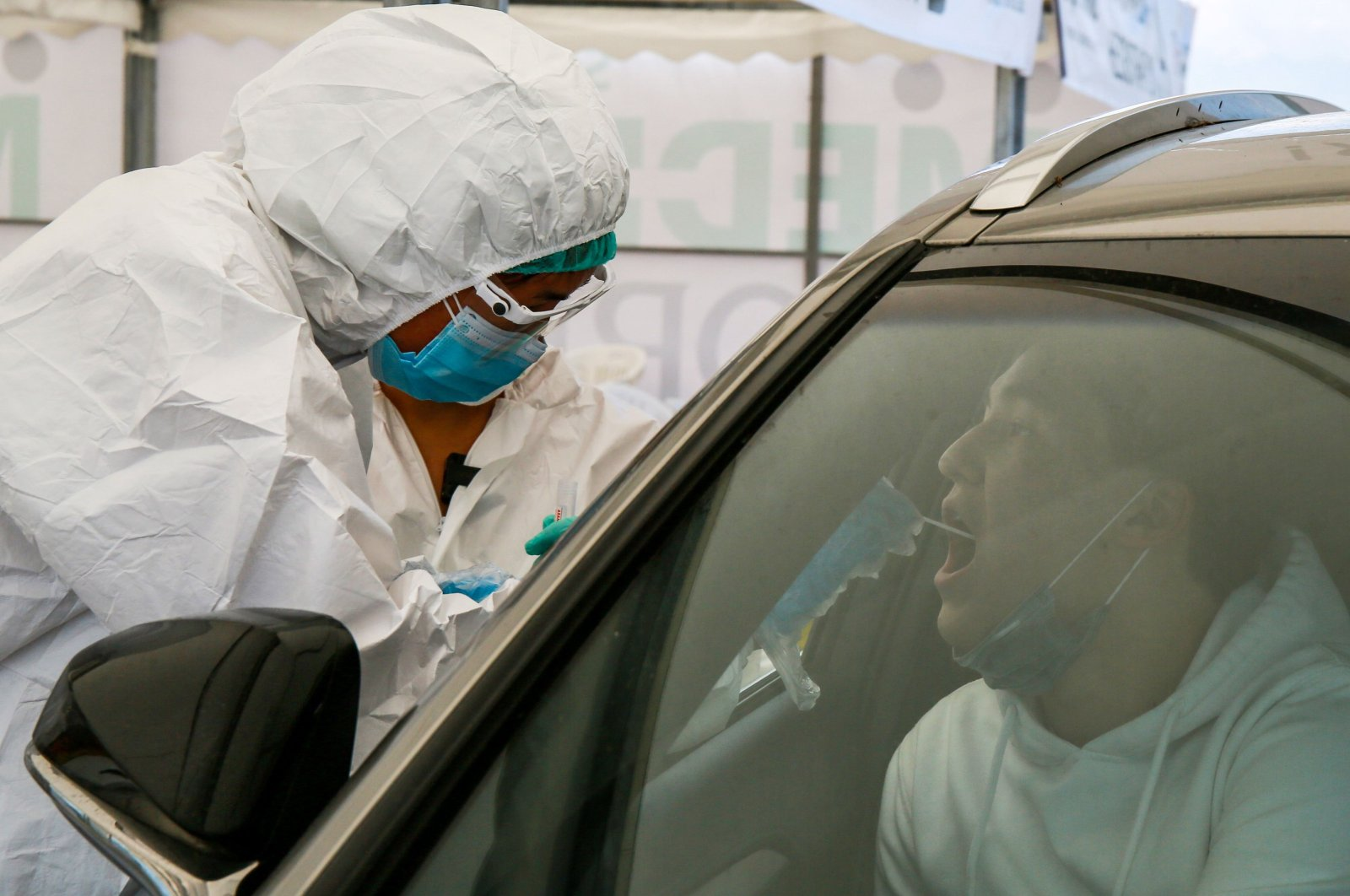 A health care worker collects sample for a COVID-19 test near Halyk Arena, Almaty, Kazakhstan, July 5, 2020. (AFP Photo)