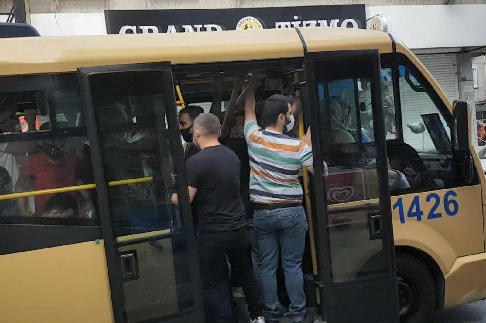 People travel in a packed minibus in Küçükçekmece district, in Istanbul, Turkey, July 8, 2020. (DHA Photo)