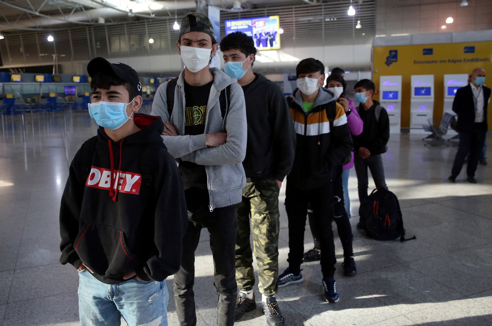 A group of unaccompanied children being transferred to Luxembourg from overcrowded migrant camps waits to board their flight at Athens International Airport, Greece, April 15, 2020. (Reuters File Photo)
