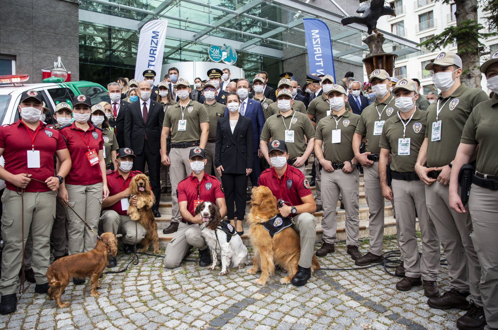Trainees of the nature and animal police pose with Interior Minister Süleyman Soylu and police dogs, in Ankara, Turkey, July 8, 2020. (AA Photo)
