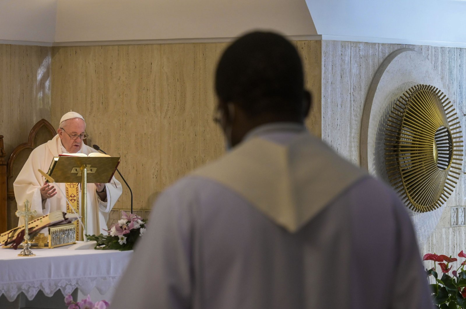 Pope Francis conducts Mass at Santa Marta Chapel to mark the seventh anniversary of his visit to Lampedusa, Vatican City, July 8, 2020. (AFP Photo / Vatican Media handout)