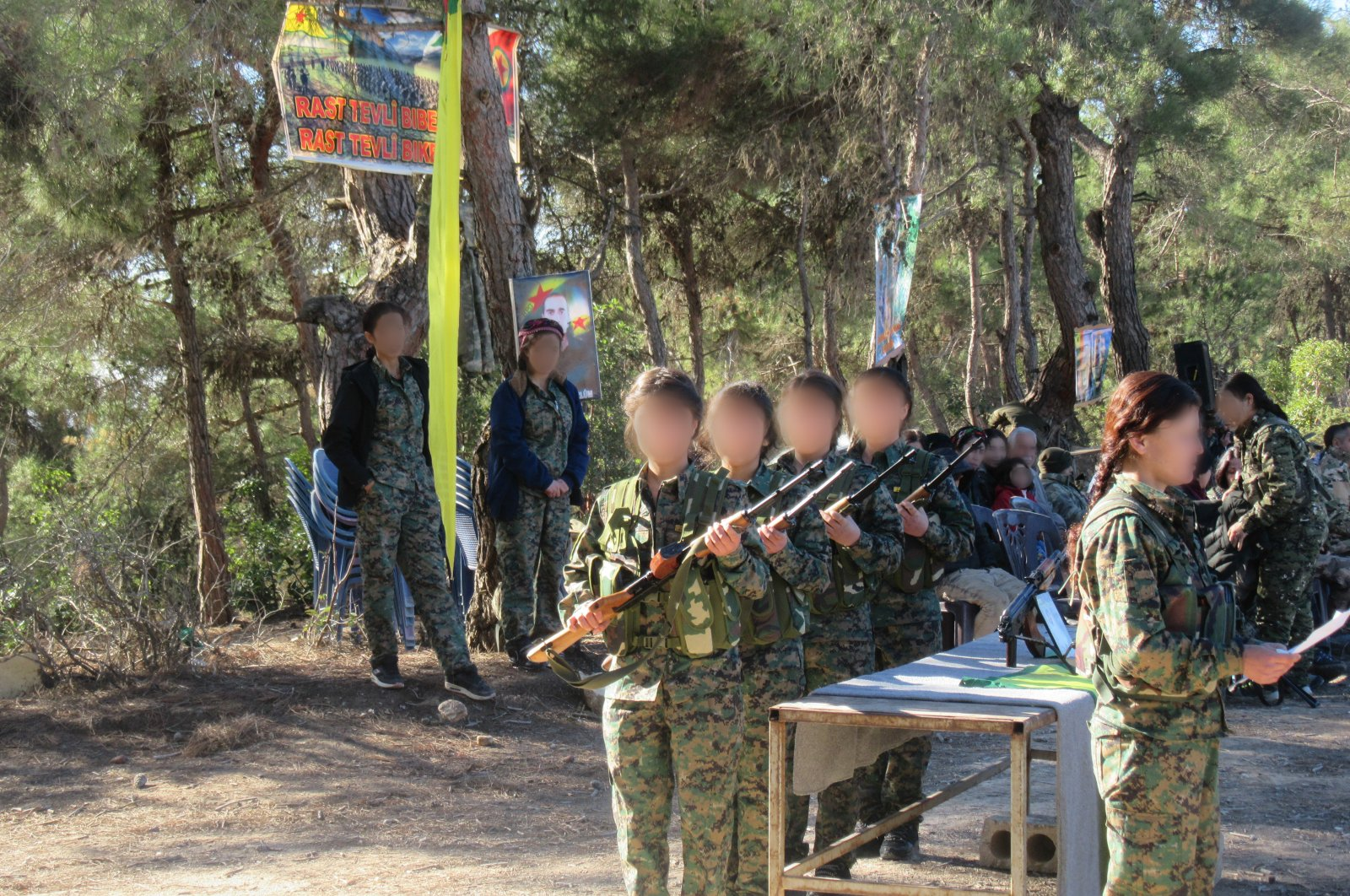 The child soldiers of the YPG terrorists are seen during training at an unknown location, Aug. 3, 2018. (AA)