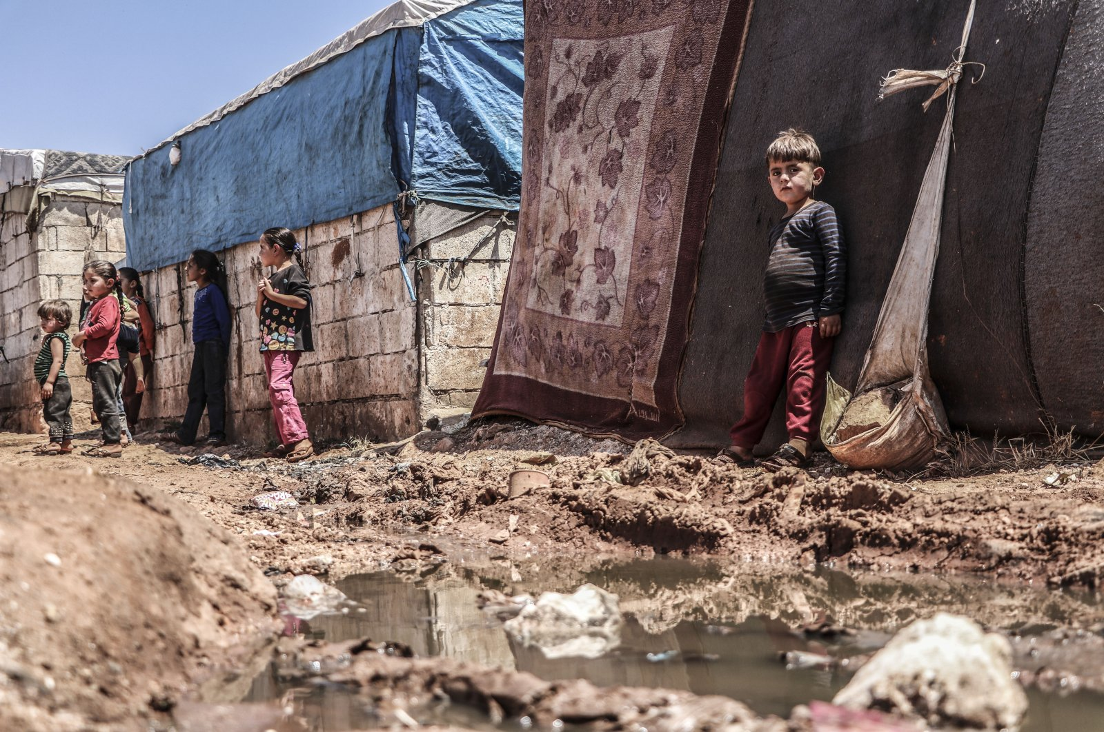 Children are seen in a tent camp, where they live under extremely unhygienic conditions and the containment of the spread of COVID-19 seems almost impossible, in Idlib, Syria, July 7, 2020 (AA Photo)