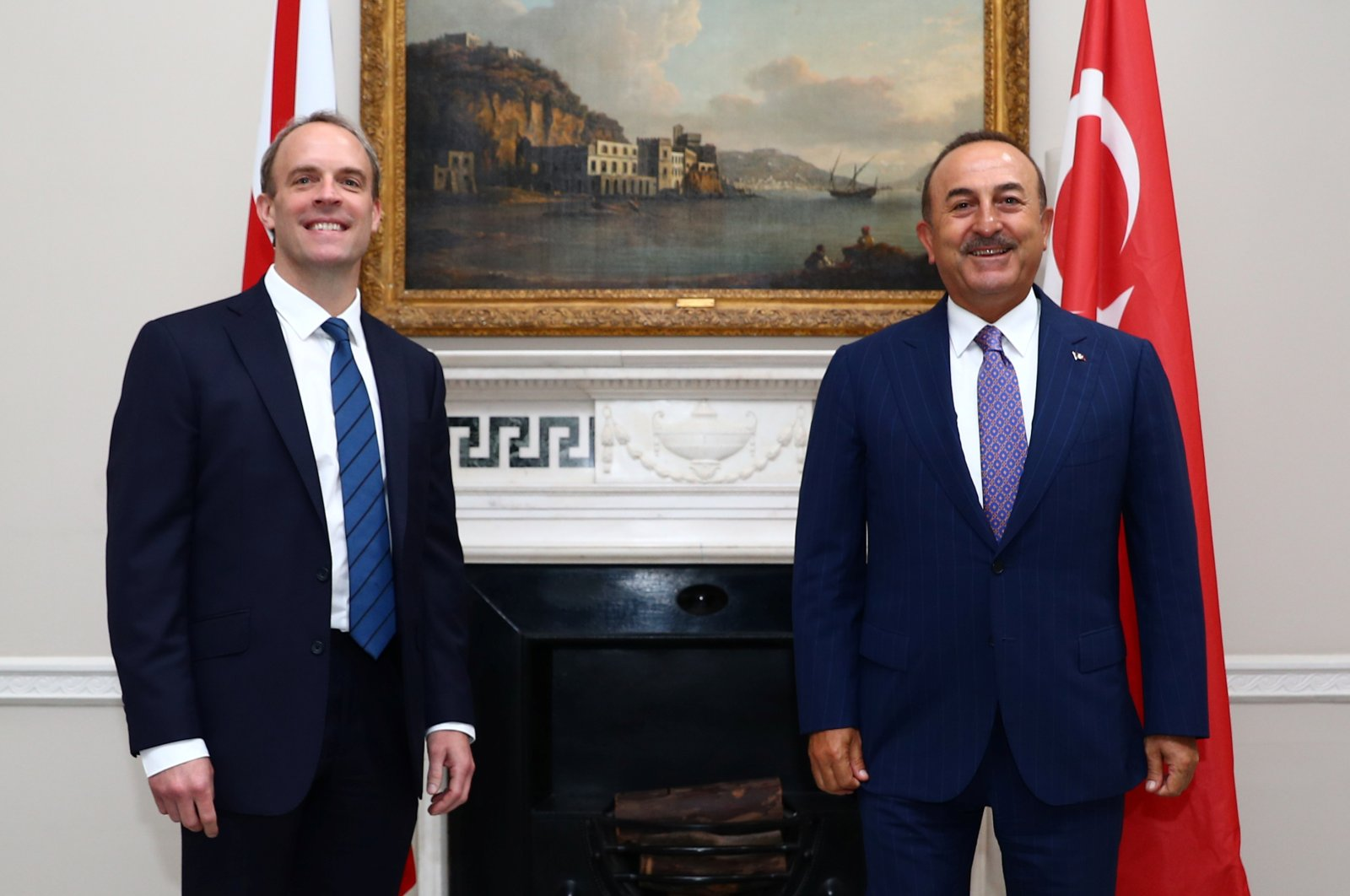 Britain's Foreign Secretary Dominic Raab (L) reacts as he poses for a photograph with Turkey's Foreign Minister Mevlüt Çavuşoğlu, at Carlton Gardens in London, on July 8, 2020. (AFP Photo)