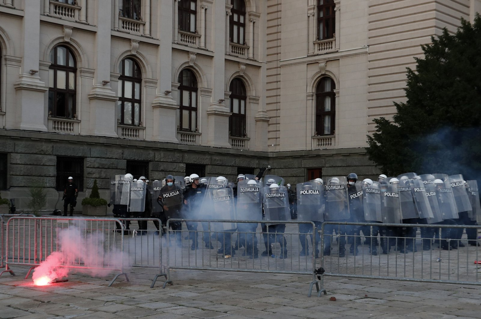 Serbian riot police guards the area by the parliament building as they clash with protesters in Belgrade, July 8, 2020. (AP Photo)