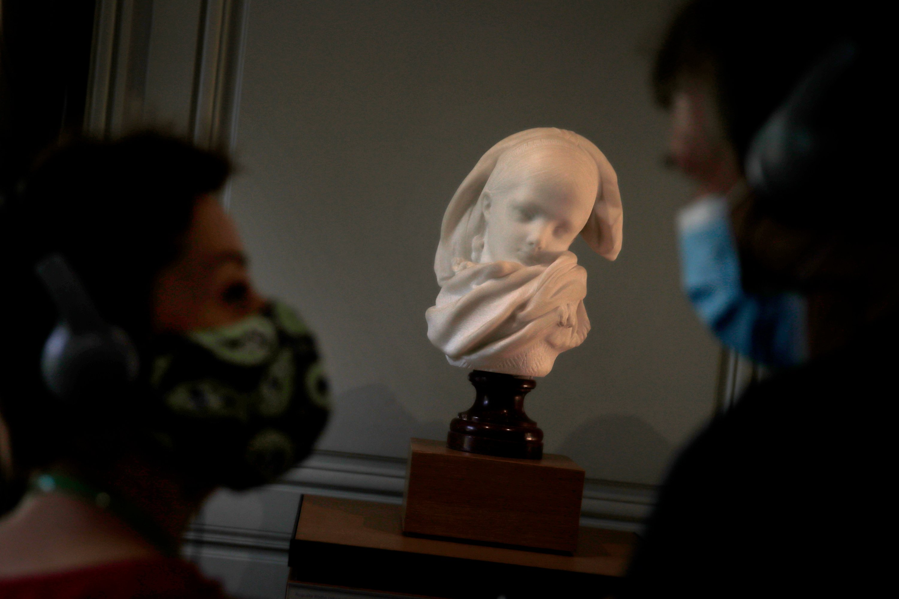 Visitors view l'Orpheline Alsacienne by French sculptor Auguste Rodin in Paris France, July 7, 2020. (AP Photo)
