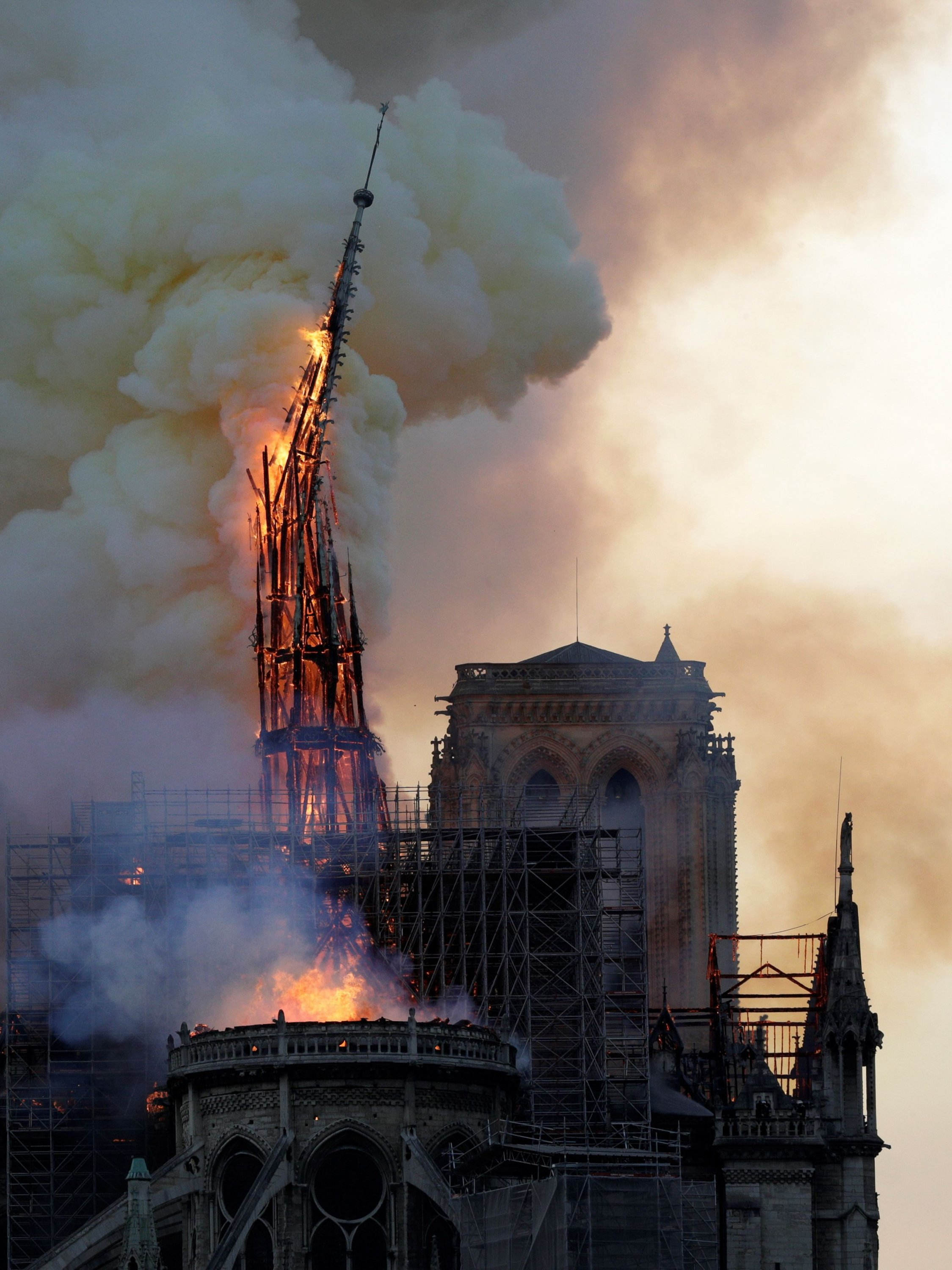 The steeple and spire of the landmark Notre-Dame Cathedral collapses as the cathedral is engulfed in flames in central Paris, France on April 15, 2019. (AFP Photo)