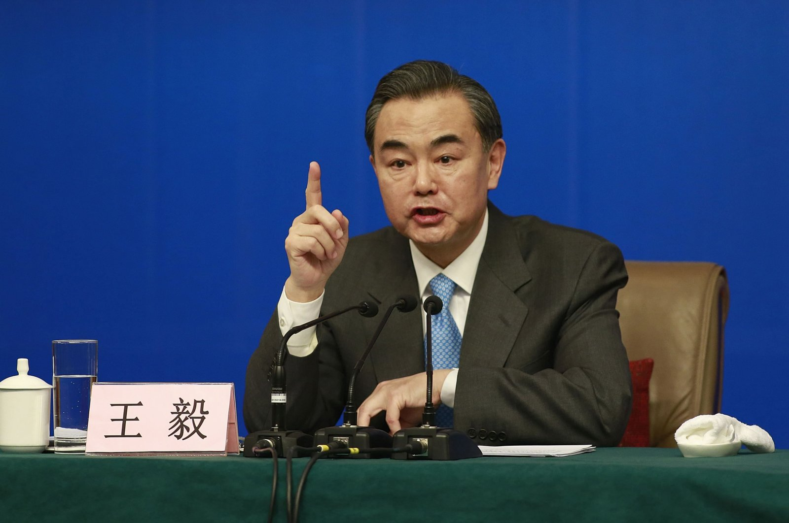 China's Foreign Minister Wang Yi gestures as he speaks during a news conference as part of the National People's Congress (NPC), in Beijing, March 8, 2014. (Reuters Photo)
