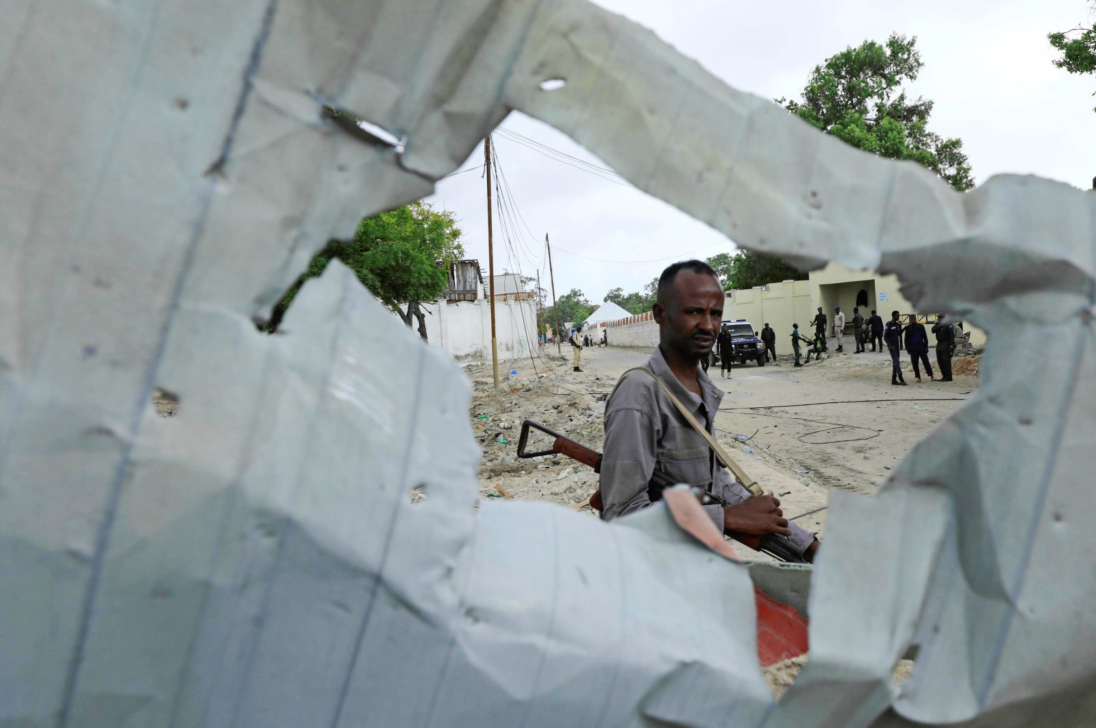 A Somali policeman walks at the crime scene after a suicide car bomber drove into a checkpoint outside the port in Mogadishu, Somalia, July 4, 2020. (Reuters Photo)