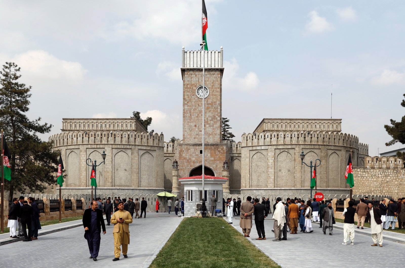 Men walk outside the presidential palace in Kabul, Afghanistan, March 9, 2020. (Reuters Photo)