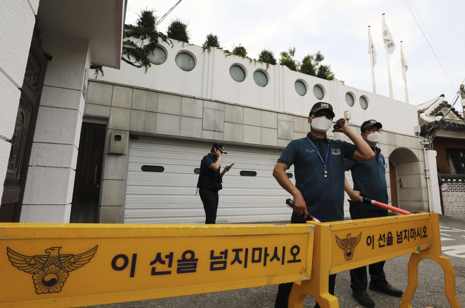 Police officers stand guard in front of the house of Seoul Mayor Park Won-soon in Seoul, South Korea, July 9, 2020. (Newsis via AP)