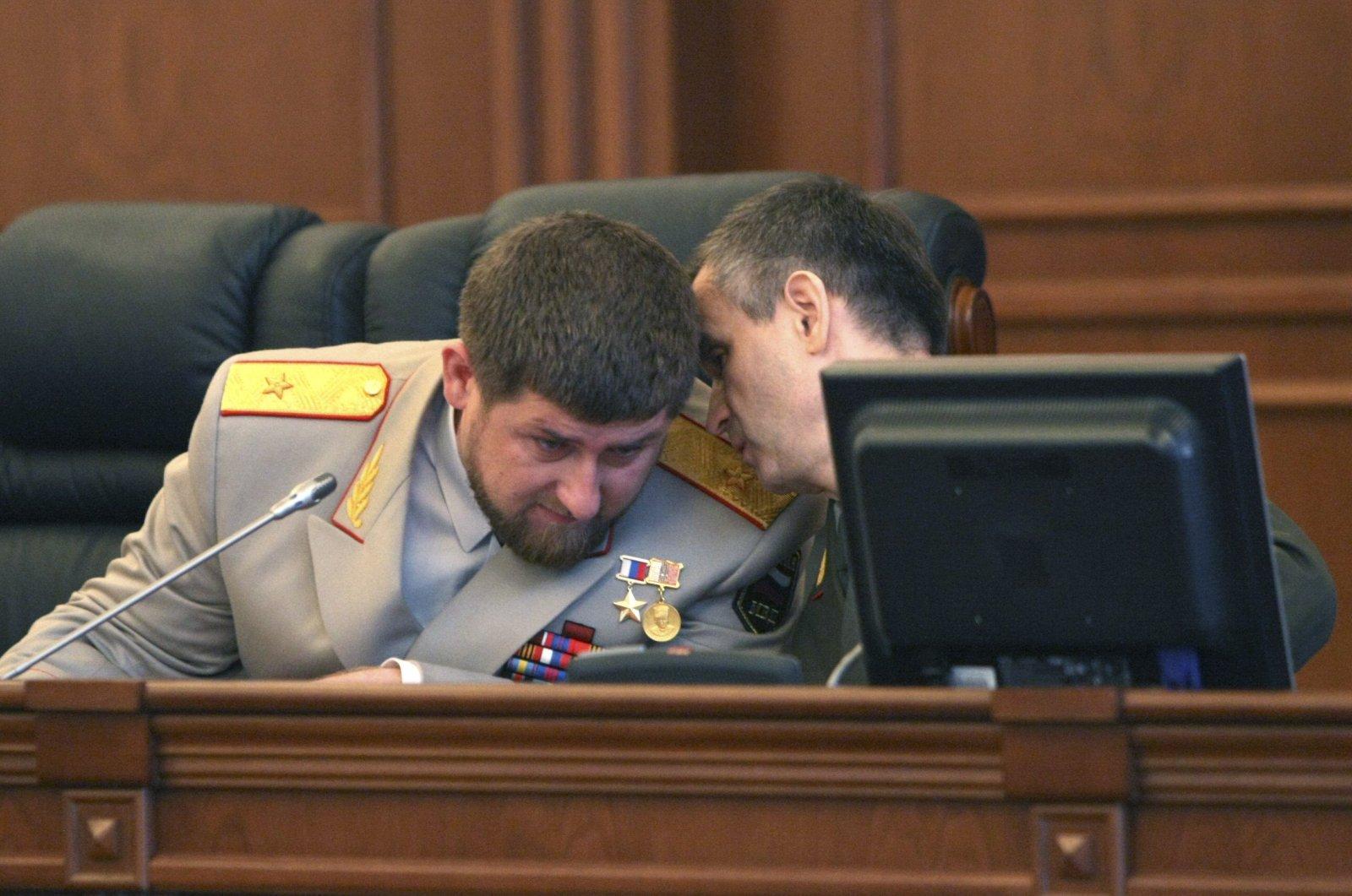 Chechen leader Ramzan Kadyrov (L) listens to then-Russian Interior Minister Rashid Nurgaliyev in the parliament in Grozny, Chechnya, Russia, Oct. 19, 2010. (Reuters Photo)