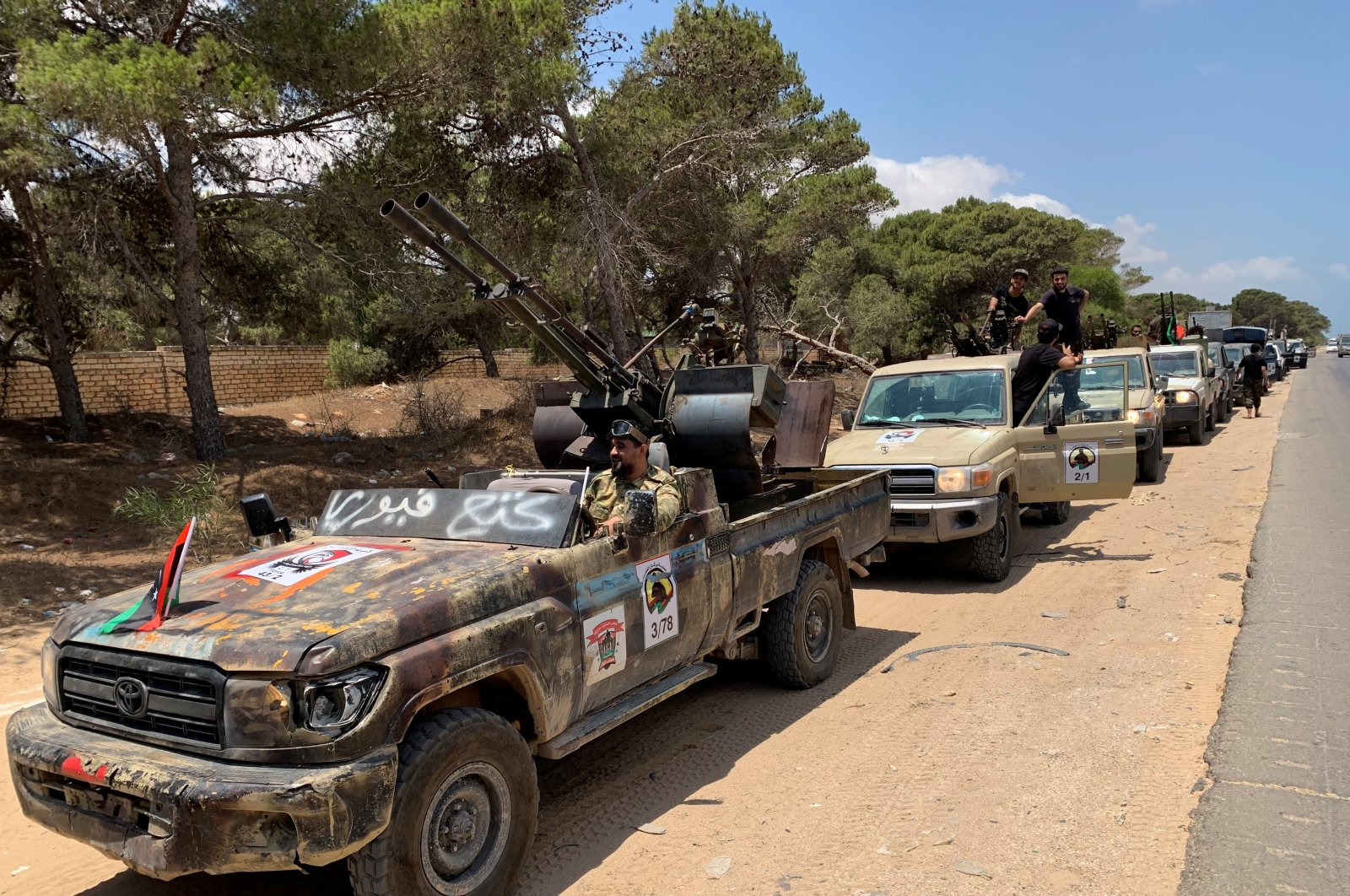 Troops loyal to Libya's internationally recognized government are seen in military vehicles as they prepare before heading to Sirte, in Tripoli, Libya, July 6, 2020. (REUTERS Photo)
