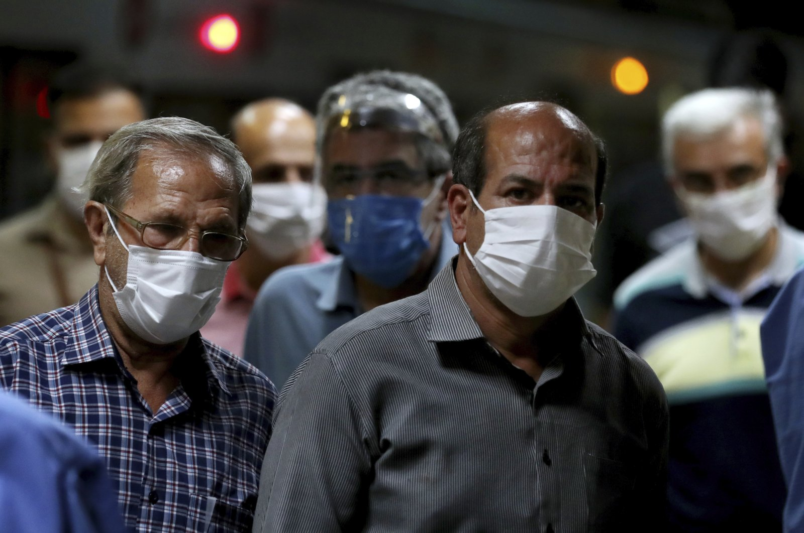People wearing protective face masks to help prevent the spread of the coronavirus walk in a metro station, in Tehran, Iran, July 8, 2020. (AP Photo)