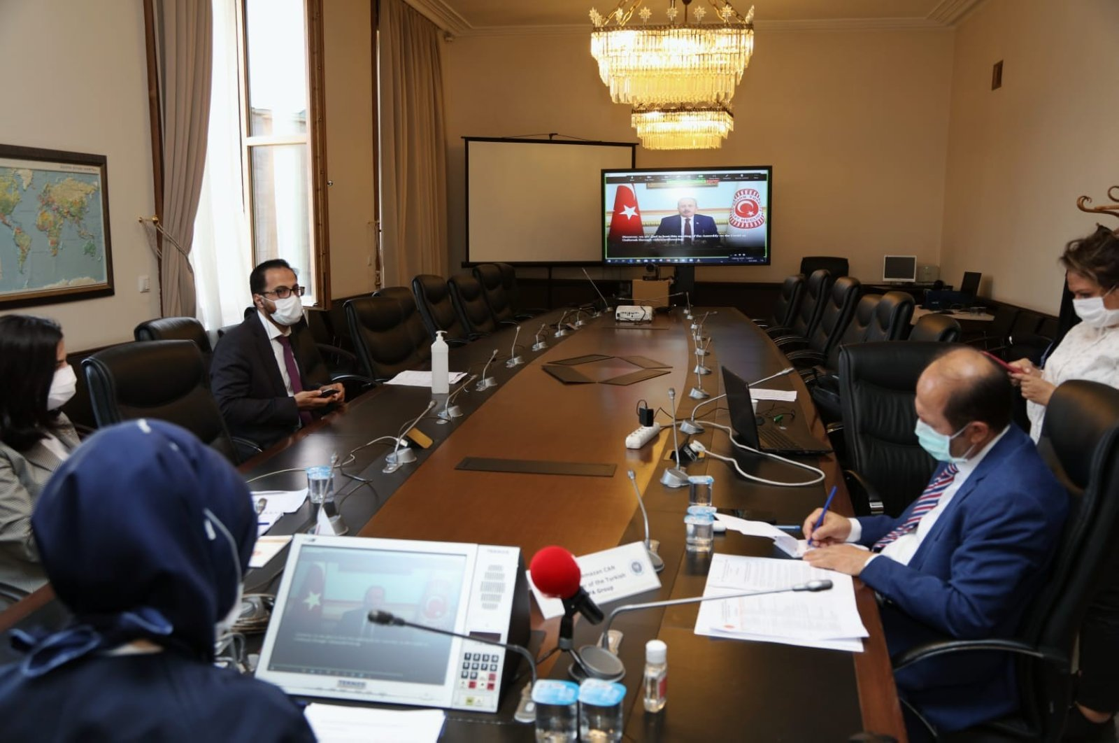 Parliament Speaker Mustafa Şentop (seen on the screen) chairs the Asian Parliamentary Assembly (APA) via videoconference, July 9, 2020. (IHA Photo)