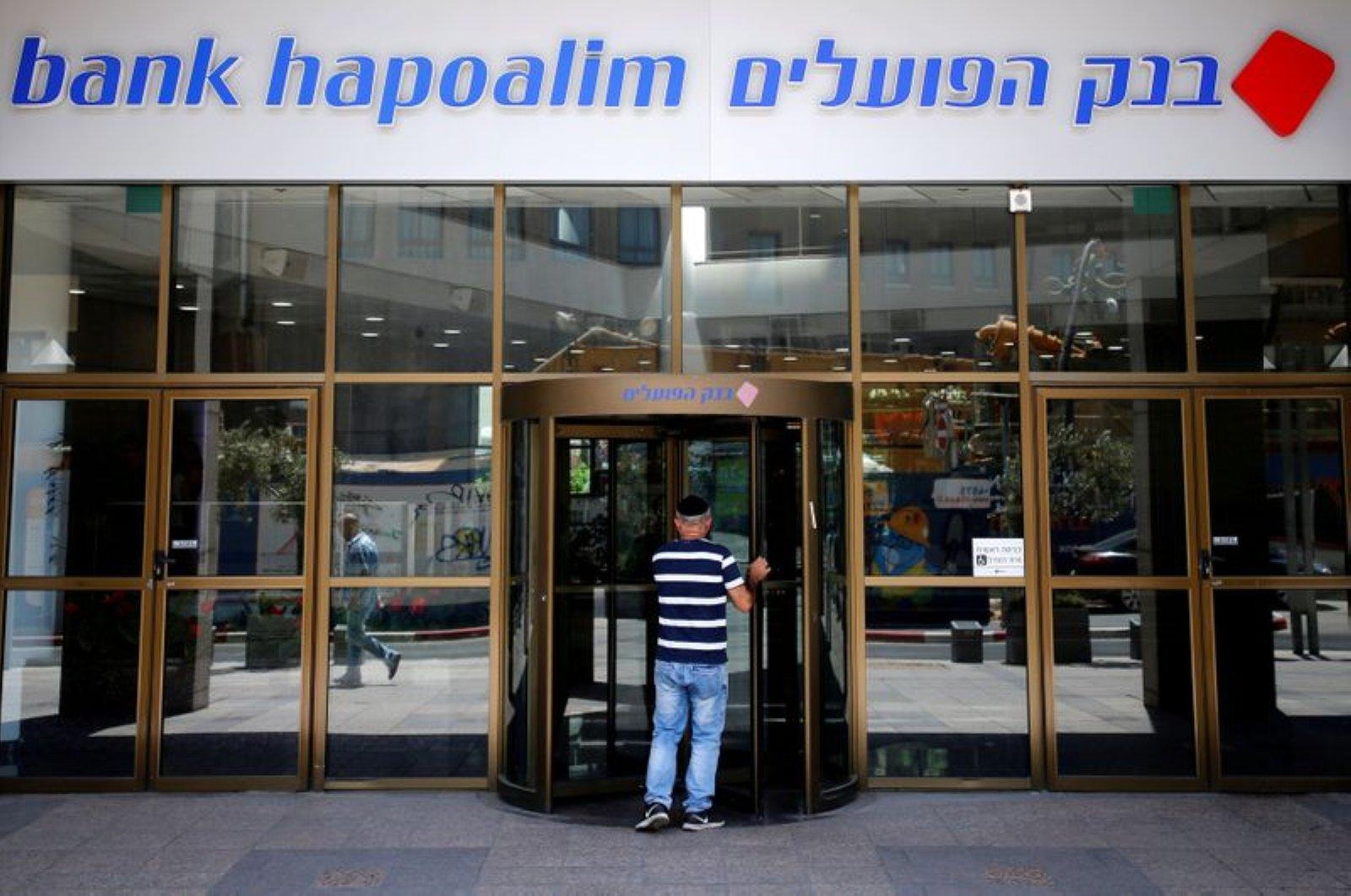 A man enters the main branch of Bank Hapoalim, in Tel Aviv, Israel July 18, 2016. (Reuters File Photo)