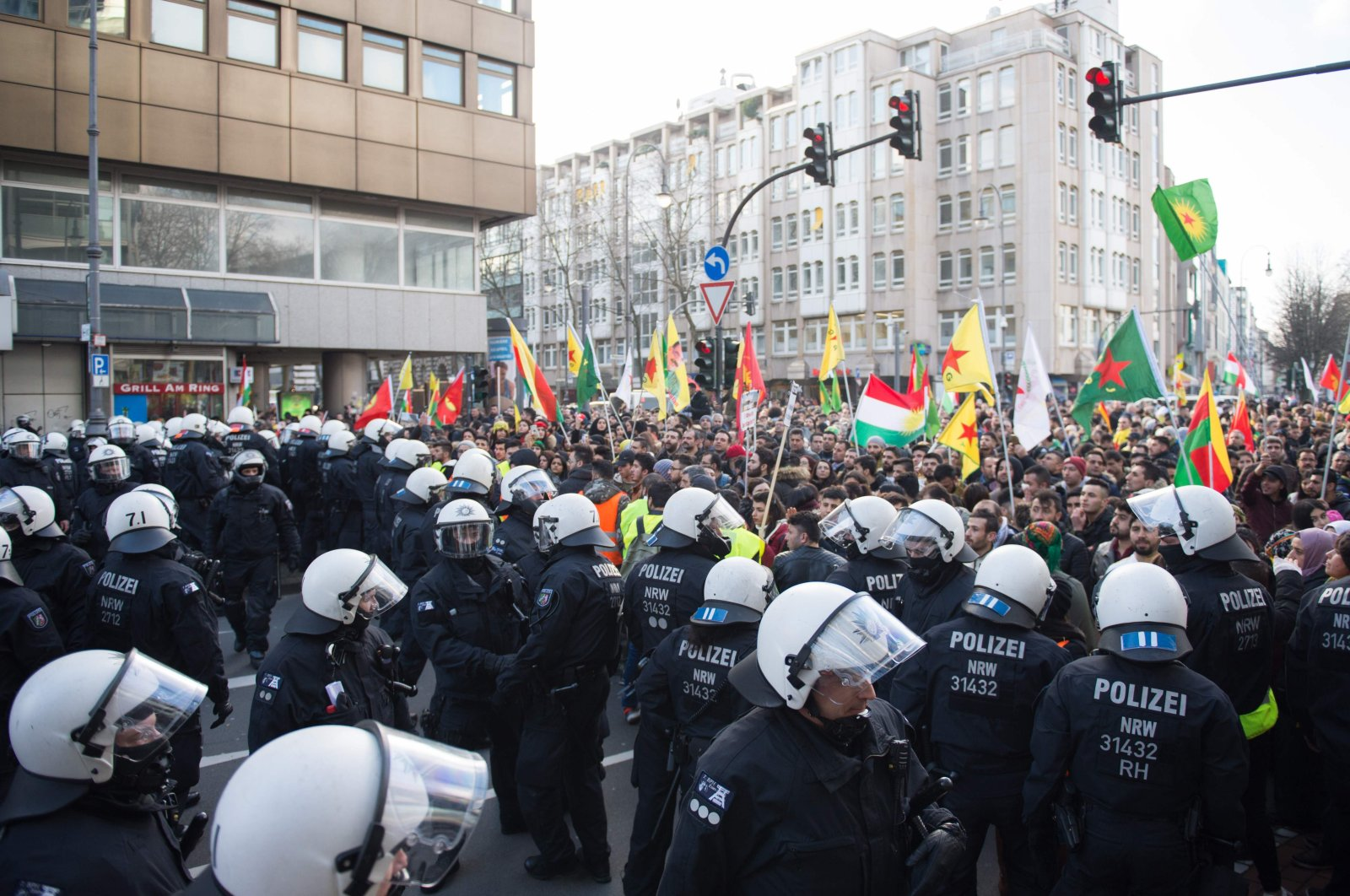 German police officers break up a mass demonstration with more than 20,000 participants protesting against Turkey's counterterrorism operation in Syria, in Cologne, western Germany, Jan. 27, 2018. (AFP Photo)