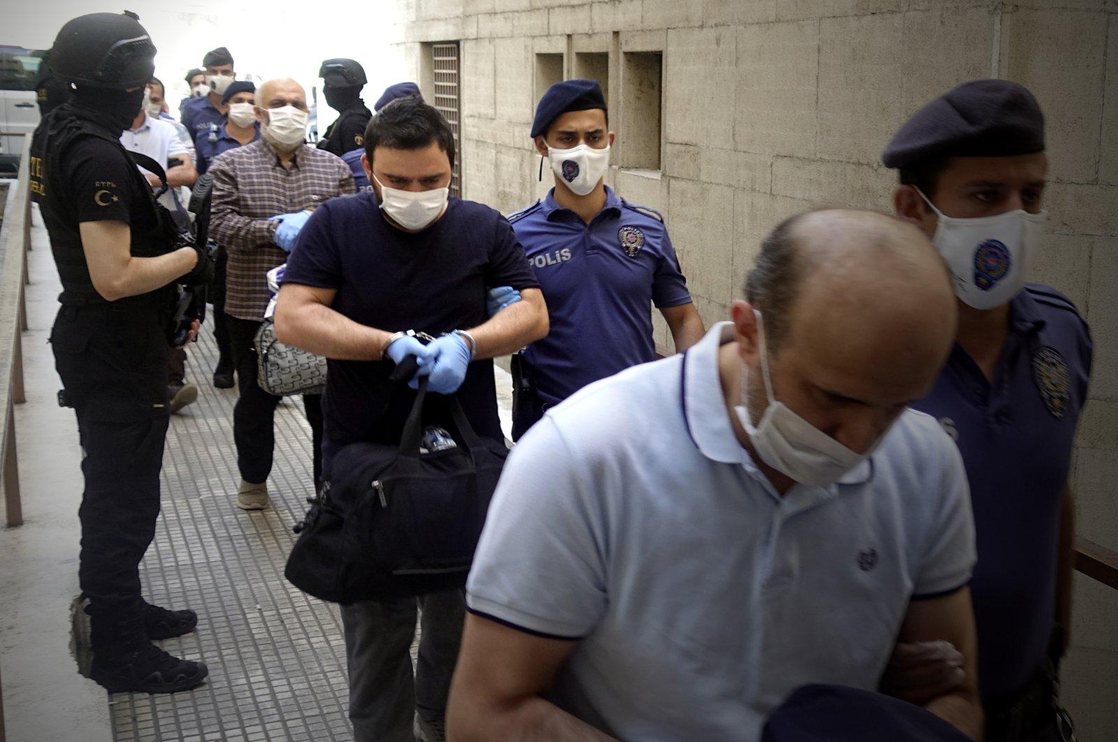 Police escort the FETÖ suspects to a courthouse, Bursa, Turkey, June 7, 2020. (AA Photo)
