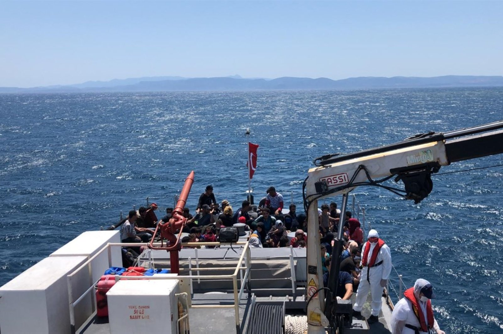 The Turkish coast guard rescues 57 migrants, who set off for the Greek island of Lesbos, in the Aegean Sea off the coast of Ayvalık in the Balıkesir province, July 9, 2020. (AA Photo)