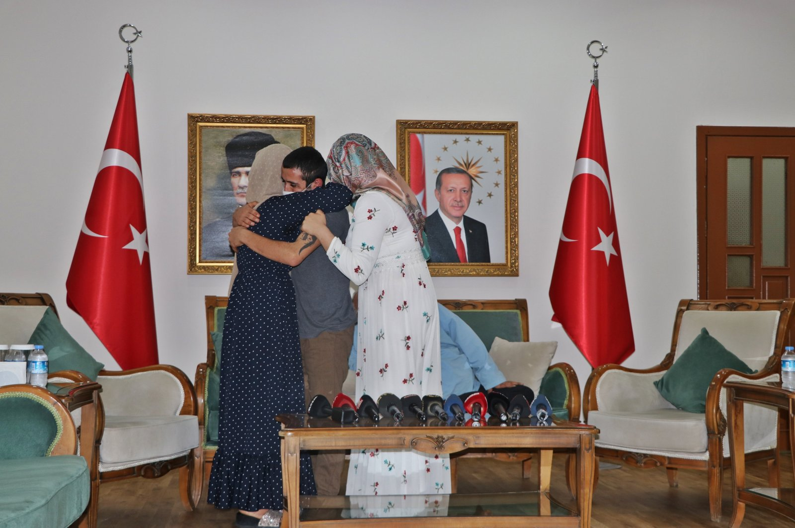 Ertaş family, who have been protesting for the return of their son from PKK, are seen celebrating after their son surrendered to security forces in Diyarbakır, southeastern Turkey, July 10, 2020. (DHA Photo)