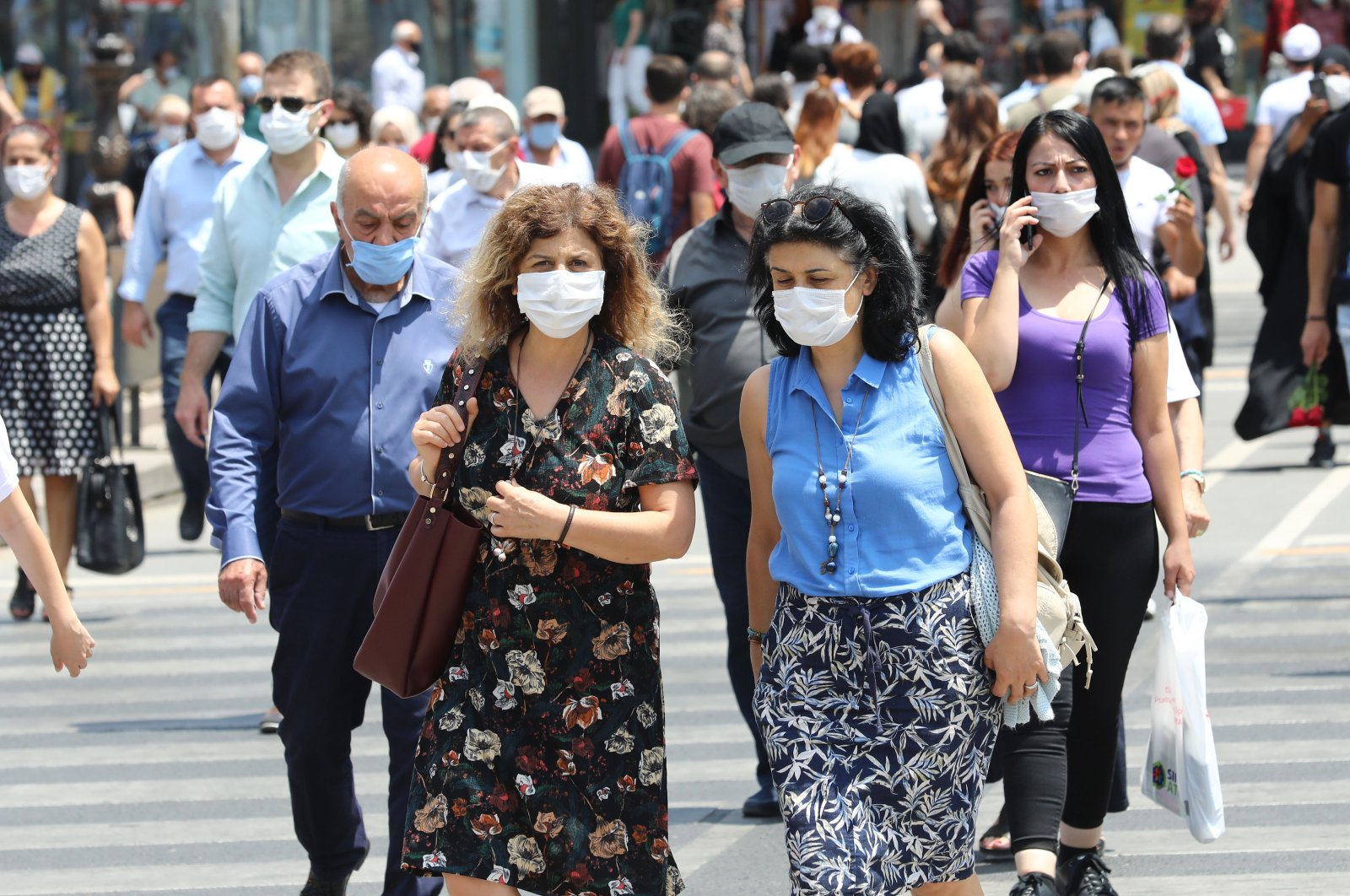 People wearing face masks walk on a street in the capital Ankara, Turkey, July 7, 2020. (AFP Photo)