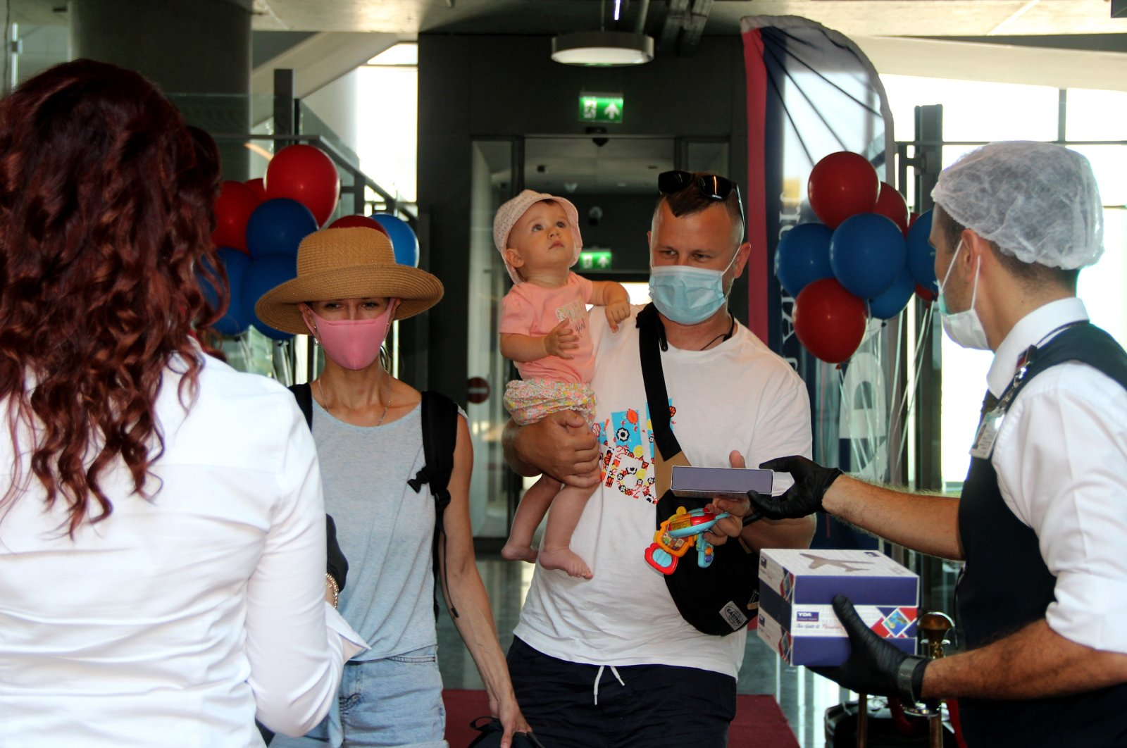 The season's first tour group from Ukraine arrives in Dalaman, in the western Muğla province, Turkey, July 4, 2020. (IHA Photo)