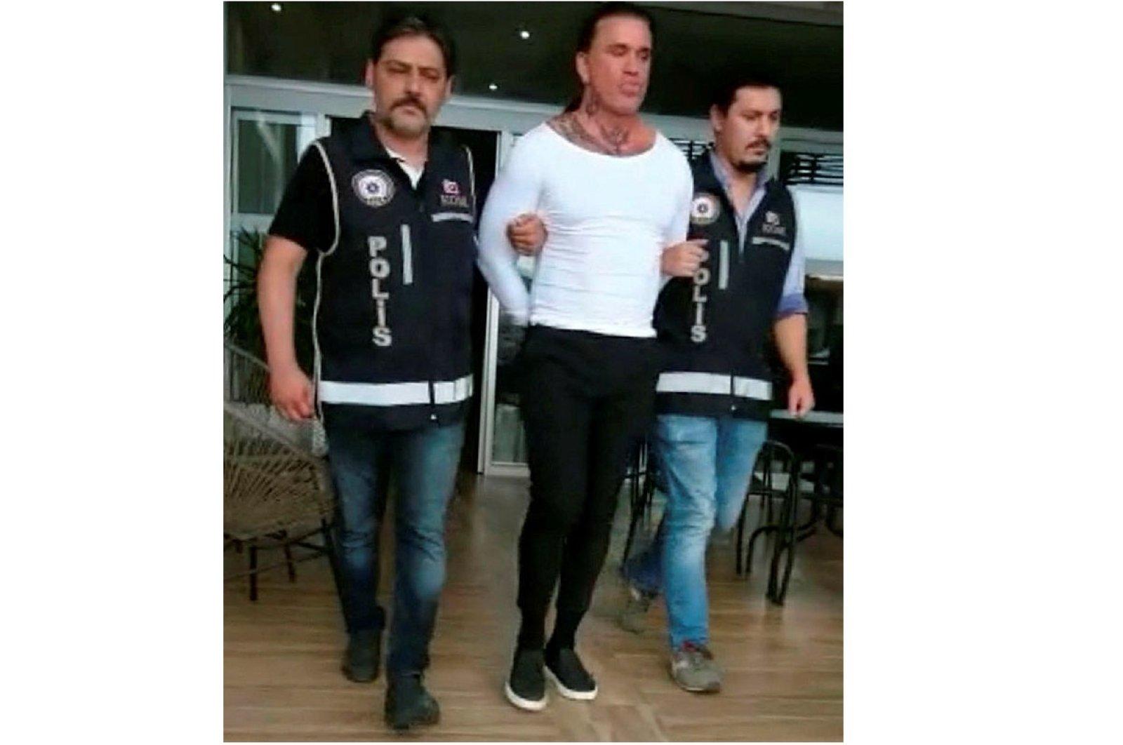 Arabacı being arrested by Turkish police in Izmir's Çeşme, July 10, 2020. (AA Photo)