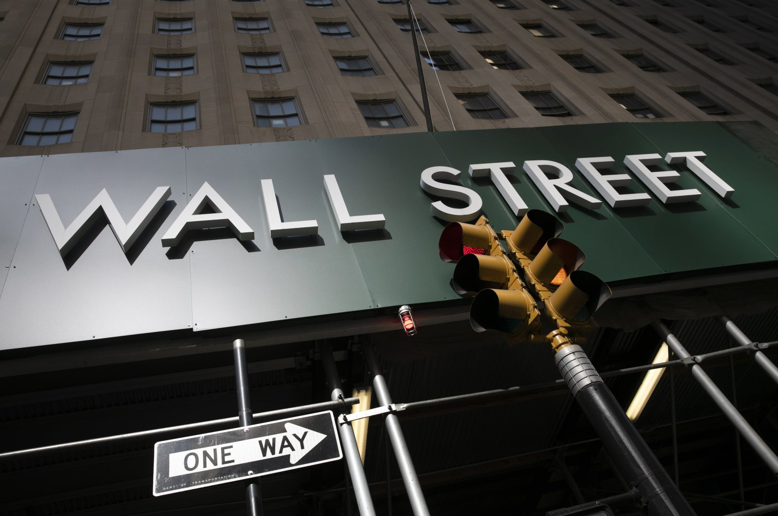 A sign for a Wall Street building is shown in New York, United States, June 16, 2020. (AP Photo)