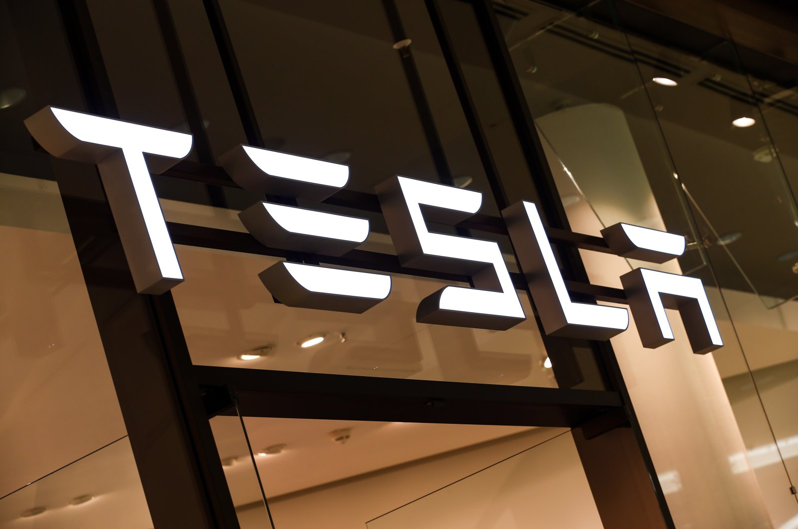 A Tesla logo is seen in a showroom in Berlin, Germany, November 2019. (EPA Photo)
