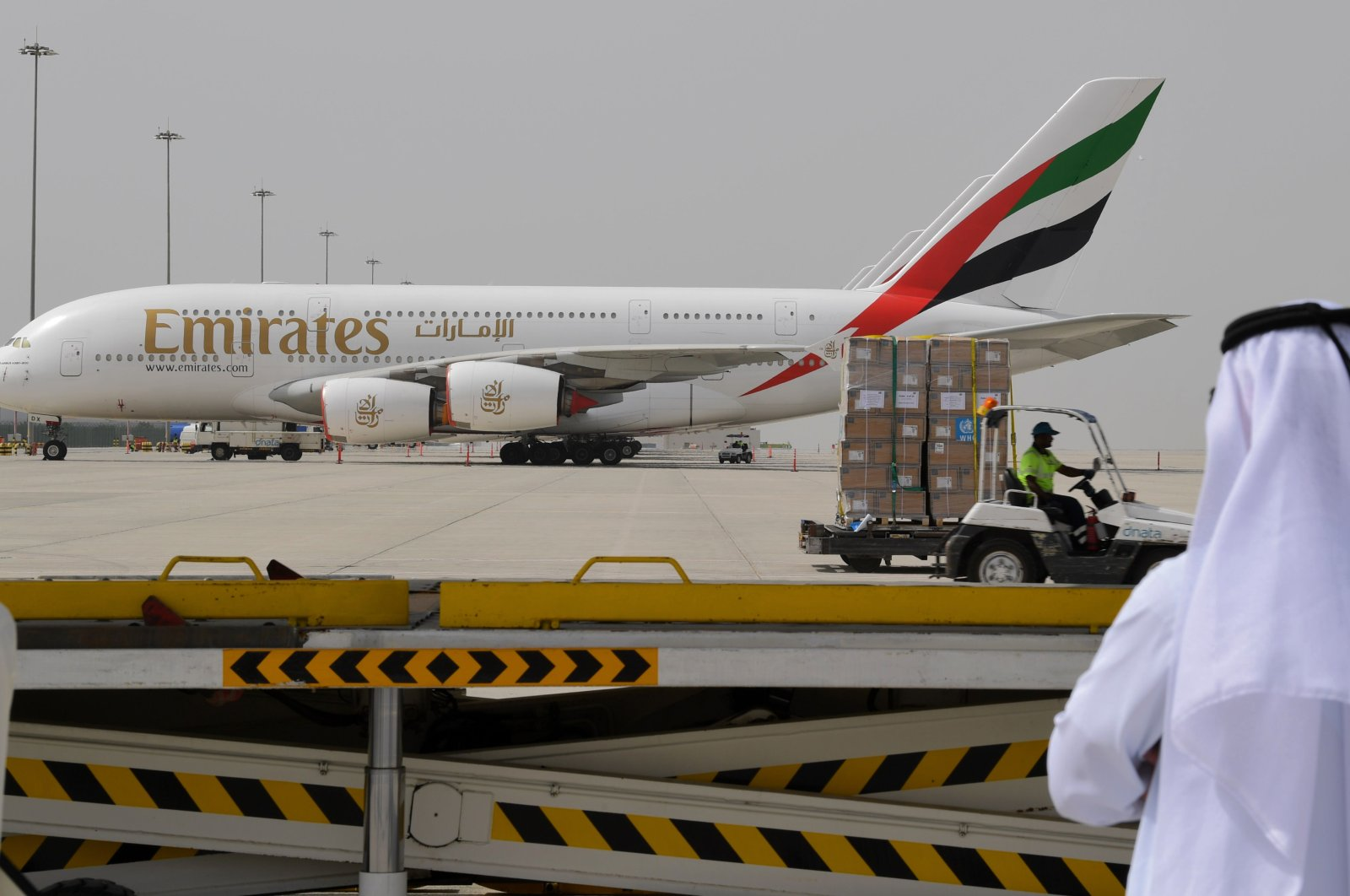 Medical equipment and coronavirus testing kits provided by the WHO are pictured passing by an Emirates airlines Airbus A380-861, at the al-Maktum International airport in Dubai, March 2, 2020. (AFP Photo)