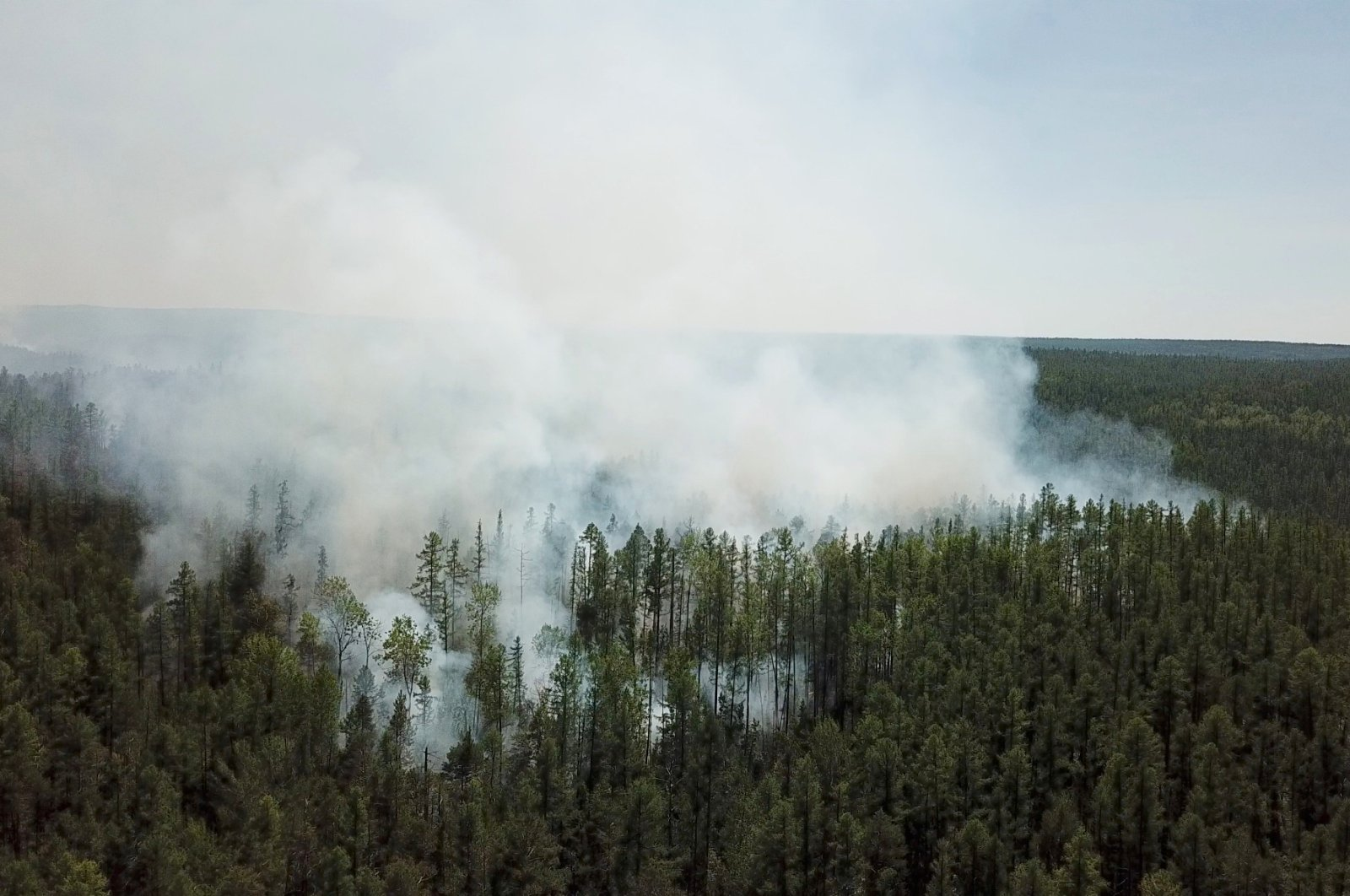 An aerial view shows smoke rising from a forest fire burning in Krasnoyarsk region, Russia, July 10, 2020. (Reuters Photo)