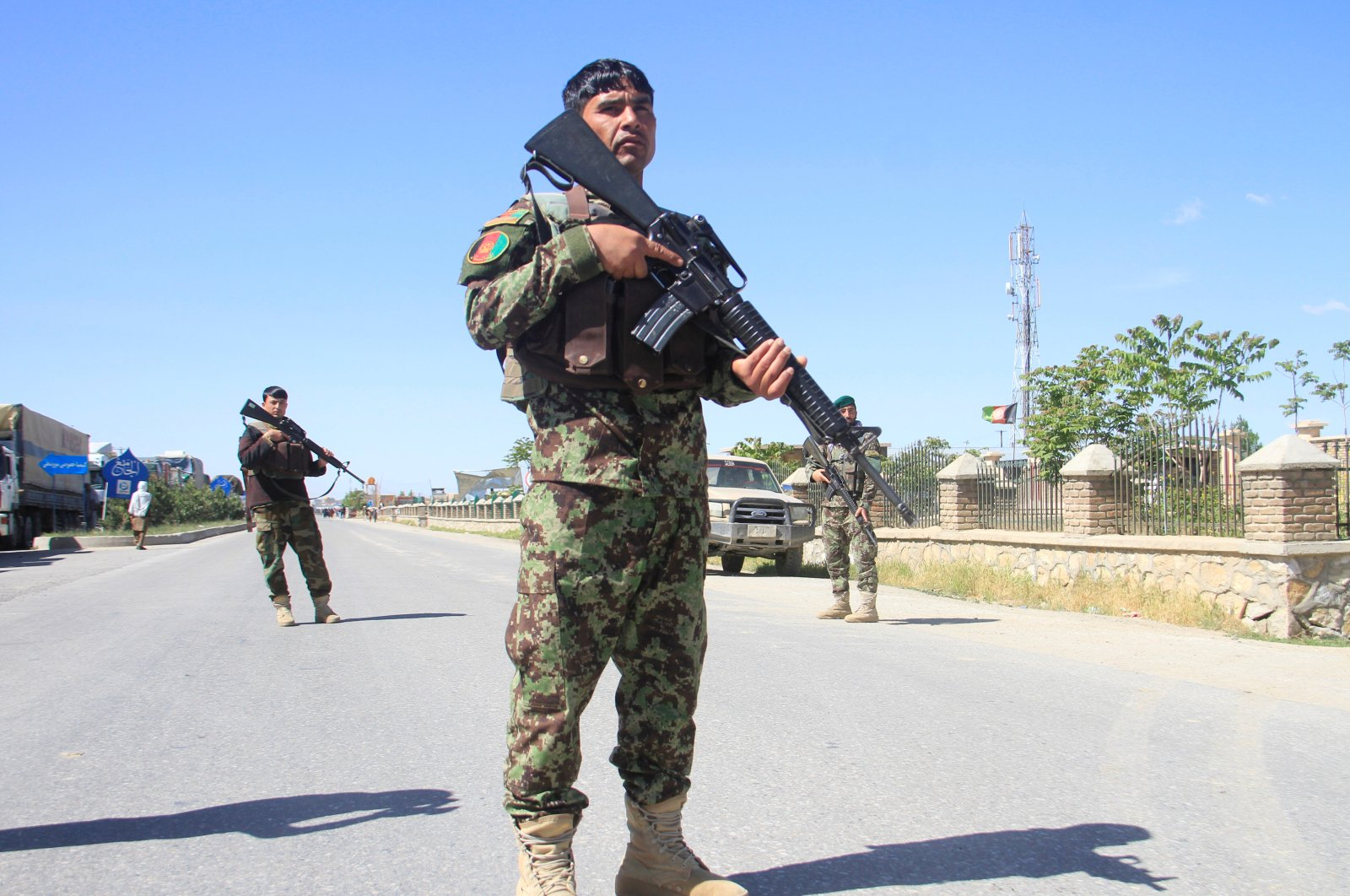 Afghan National Army officers stand guard at the site of a blast in Ghazni province, Afghanistan May 18, 2020. (Reuters Photo)