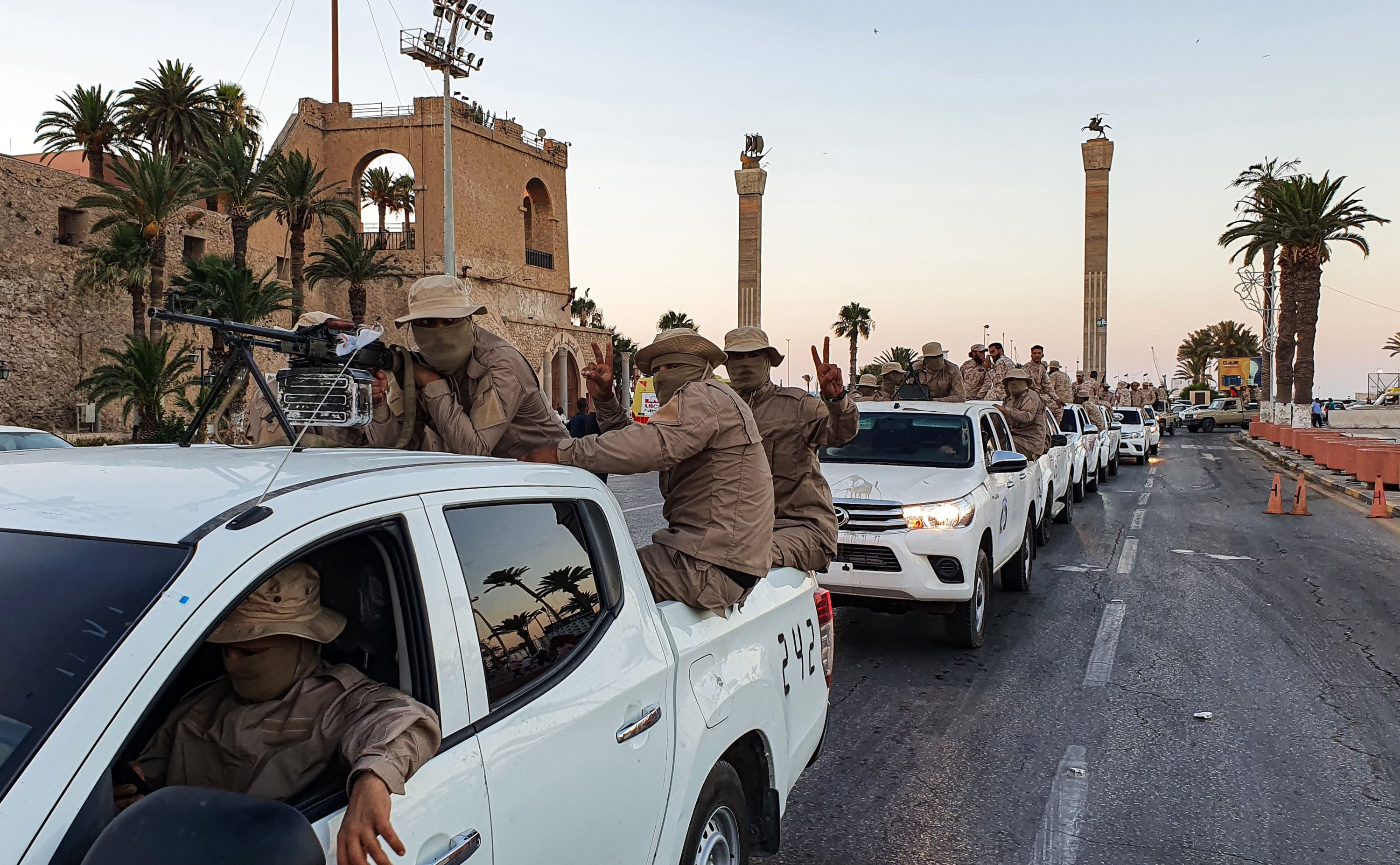 Vehicles of the 'Tripoli Brigade', a group loyal to the UN-recognised Government of National Accord (GNA), parade through the Martyrs' Square at the centre of the GNA-held Libyan capital Tripoli, July 10, 2020. (AFP)