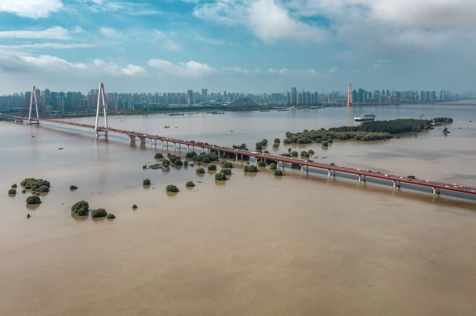 This aerial photo taken on July 8, 2020 shows trees and streets inundated by floodwaters from the swollen Yangtze River following seasonal rains in Wuhan in China's central Hubei province. (AFP Photo)