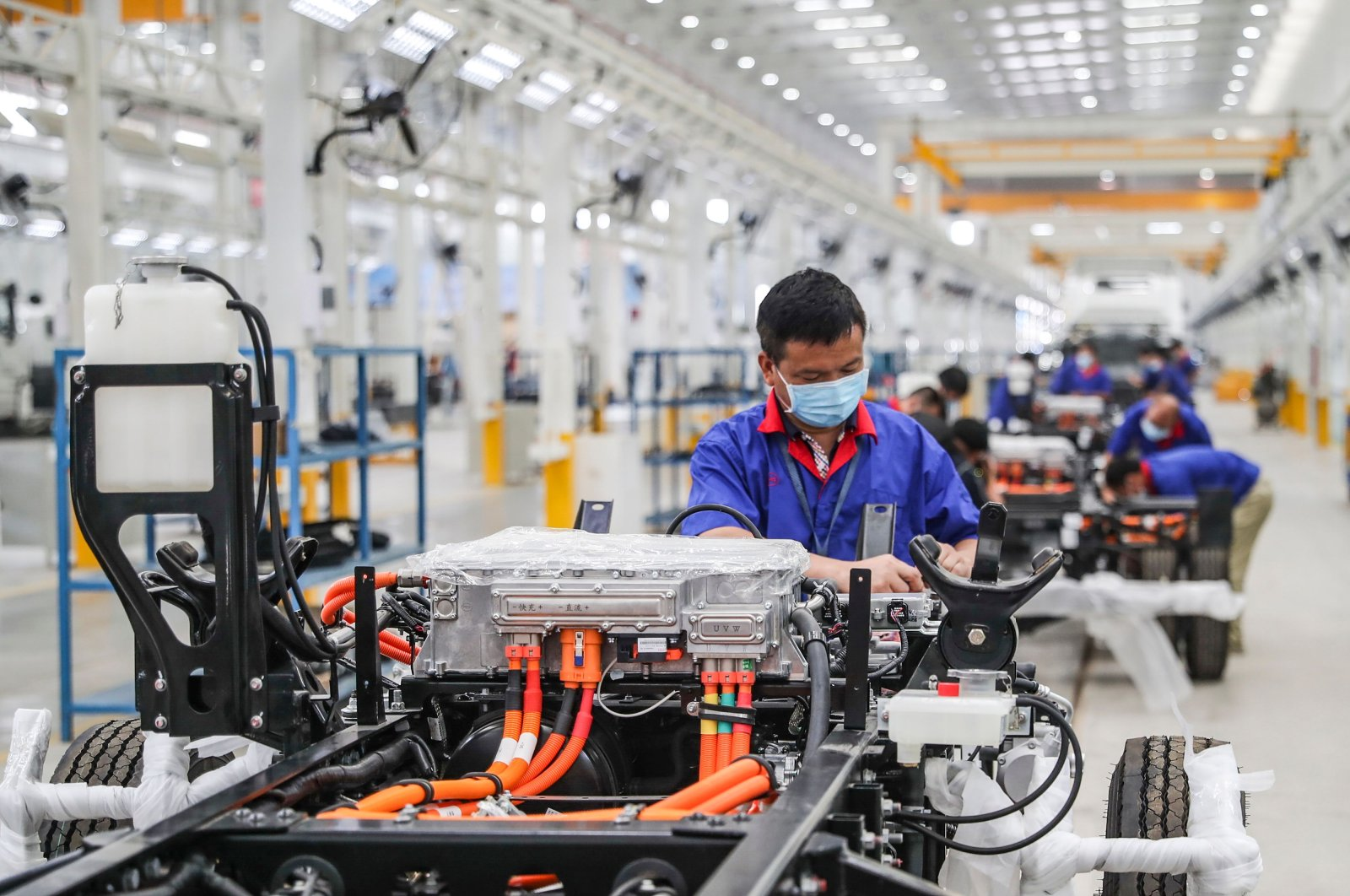 An employee working on a new energy vehicle assembly line at a BYD factory in Huaian in China's eastern Jiangsu province, July 6, 2020. (AFP Photo)