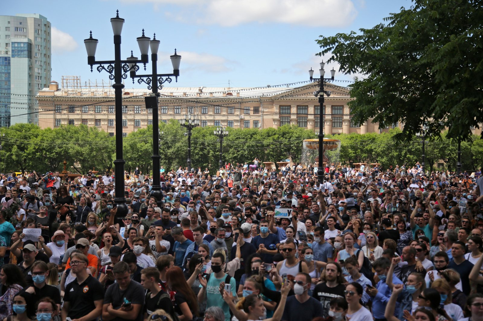 People take part in a rally in support of the governor of the far eastern Khabarovsk region Sergei Furgal, who is being held in pre-trial detention after being charged with organizing the murder of several entrepreneurs 15 years ago, Khabarovsk, Russia July 11, 2020. (Reuters Photo)