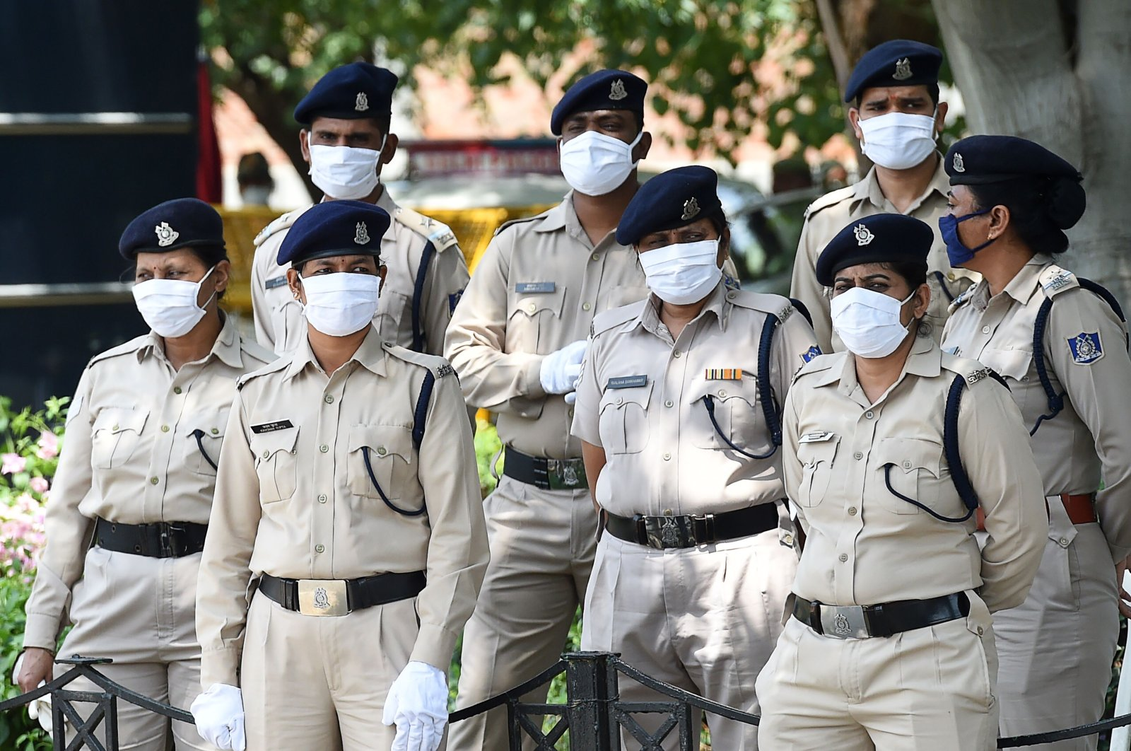 Indian security personnel stand guard as Tibetan Youth Congress (TYC) activists stage a protest against China in support of India outside the Chinese embassy in New Delhi, July 11, 2020. (AFP Photo)