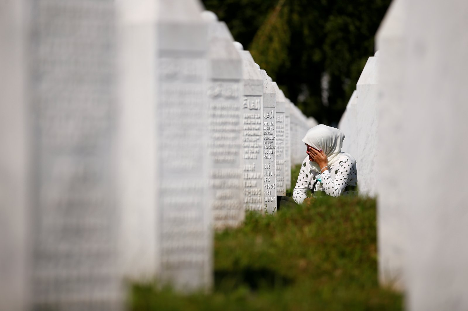 A woman cries at a graveyard ahead of a mass funeral in Potocari near Srebrenica, Bosnia and Herzegovina, July 11, 2020. (Reuters Photo)