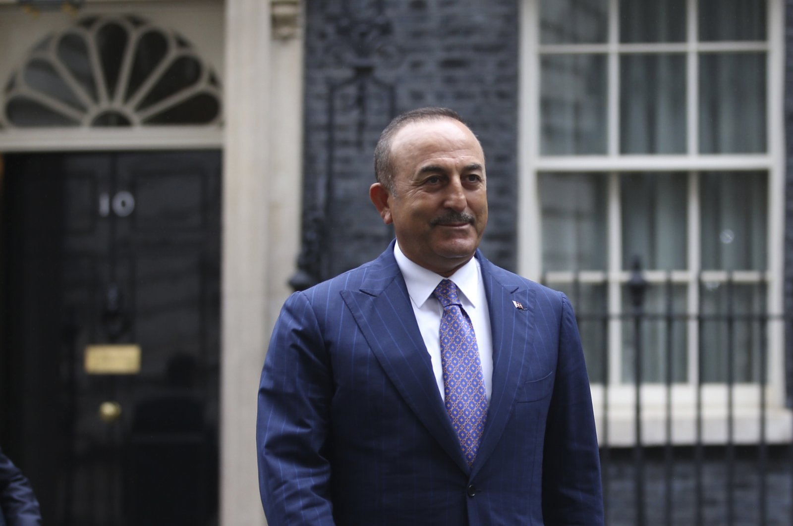 Foreign Minister Mevlüt Çavuşoğlu leaves number 10 Downing Street after a meeting with British Prime Minister Boris Johnson, in London, July 8, 2020. (AP)