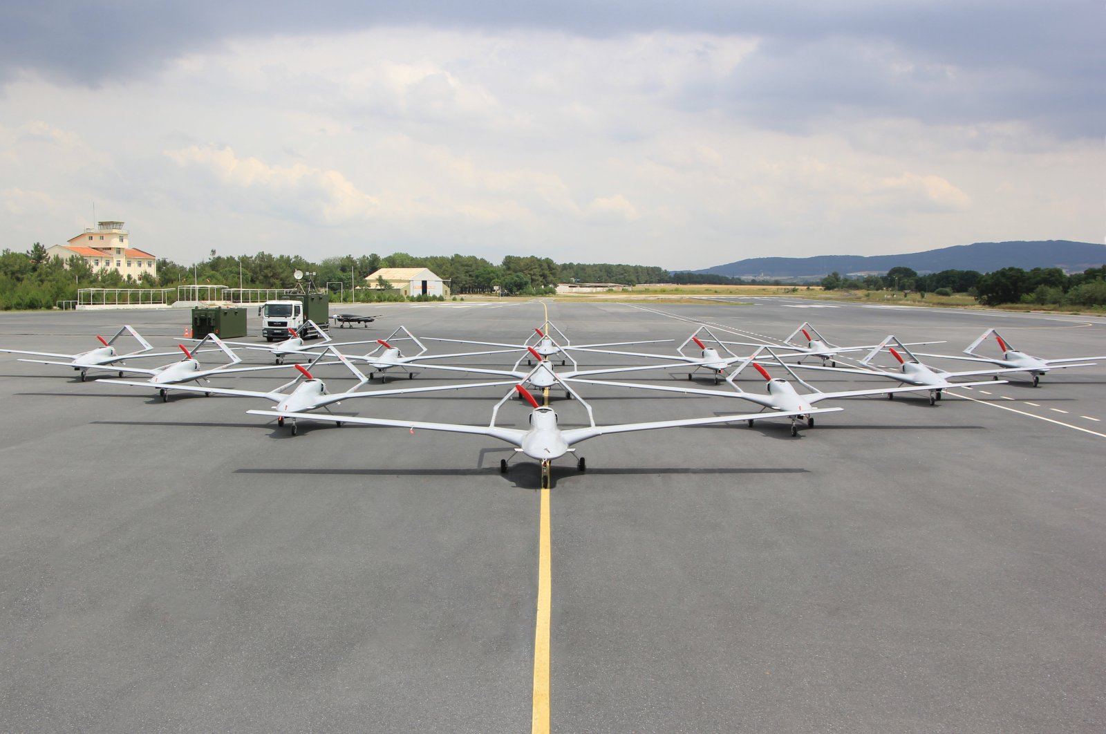 Bayraktar TB2 unmanned aerial vehicles (UAVs) are seen parked at an airfield in Istanbul, June 11, 2020. (AA Photo)