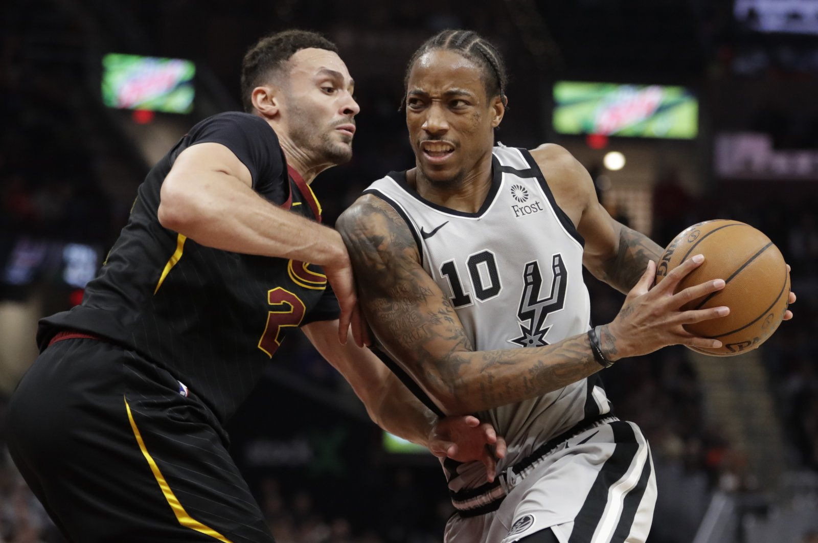 San Antonio Spurs' DeMar DeRozan (10) drives past Cleveland Cavaliers' Larry Nance Jr. (22) during an NBA game in Cleveland, U.S., March 8, 2020. (AP Photo)